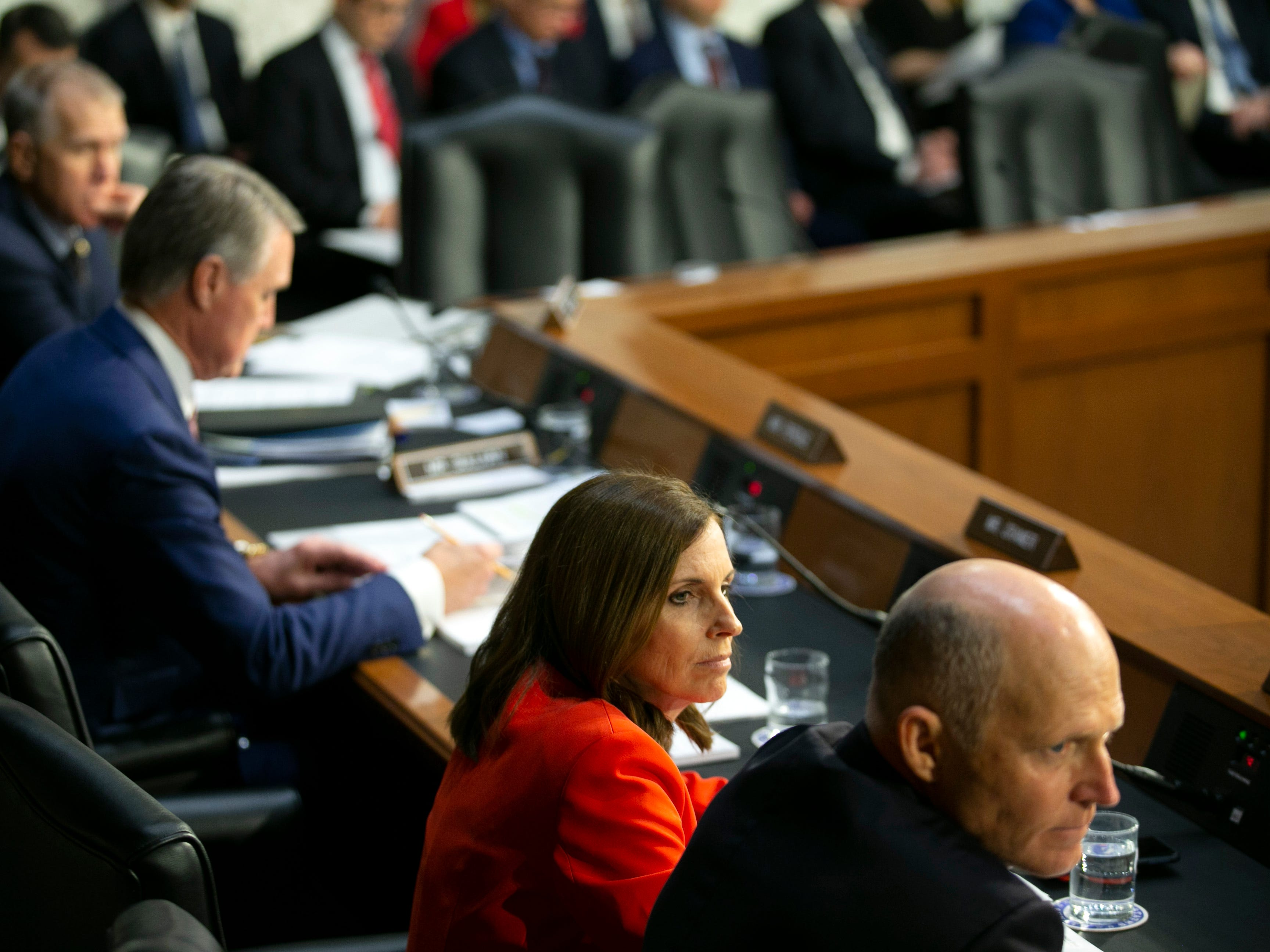 U.S. Sen. Martha McSally listens alongside Senator Rick Scott, R-Fla., during the U.S. Senate Committee on Armed Services  hearing at the U.S. Capitol in Washington D.C. on Feb. 5, 2019.