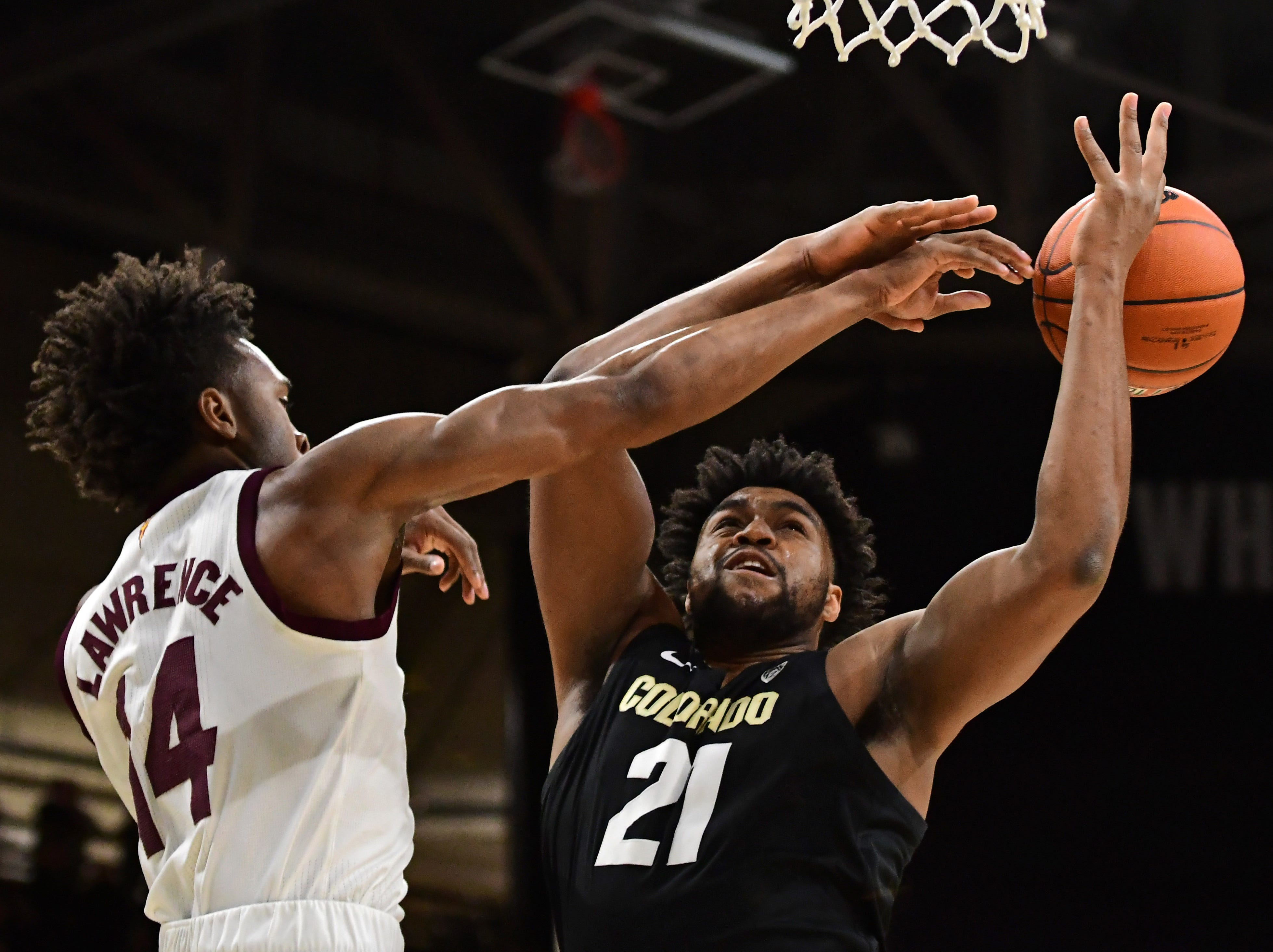 Feb 13, 2019; Boulder, CO, USA; Arizona State Sun Devils forward Kimani Lawrence (14) blocks a shot attempt by Colorado Buffaloes forward Evan Battey (21) n the first half at the CU Events Center. Mandatory Credit: Ron Chenoy-USA TODAY Sports