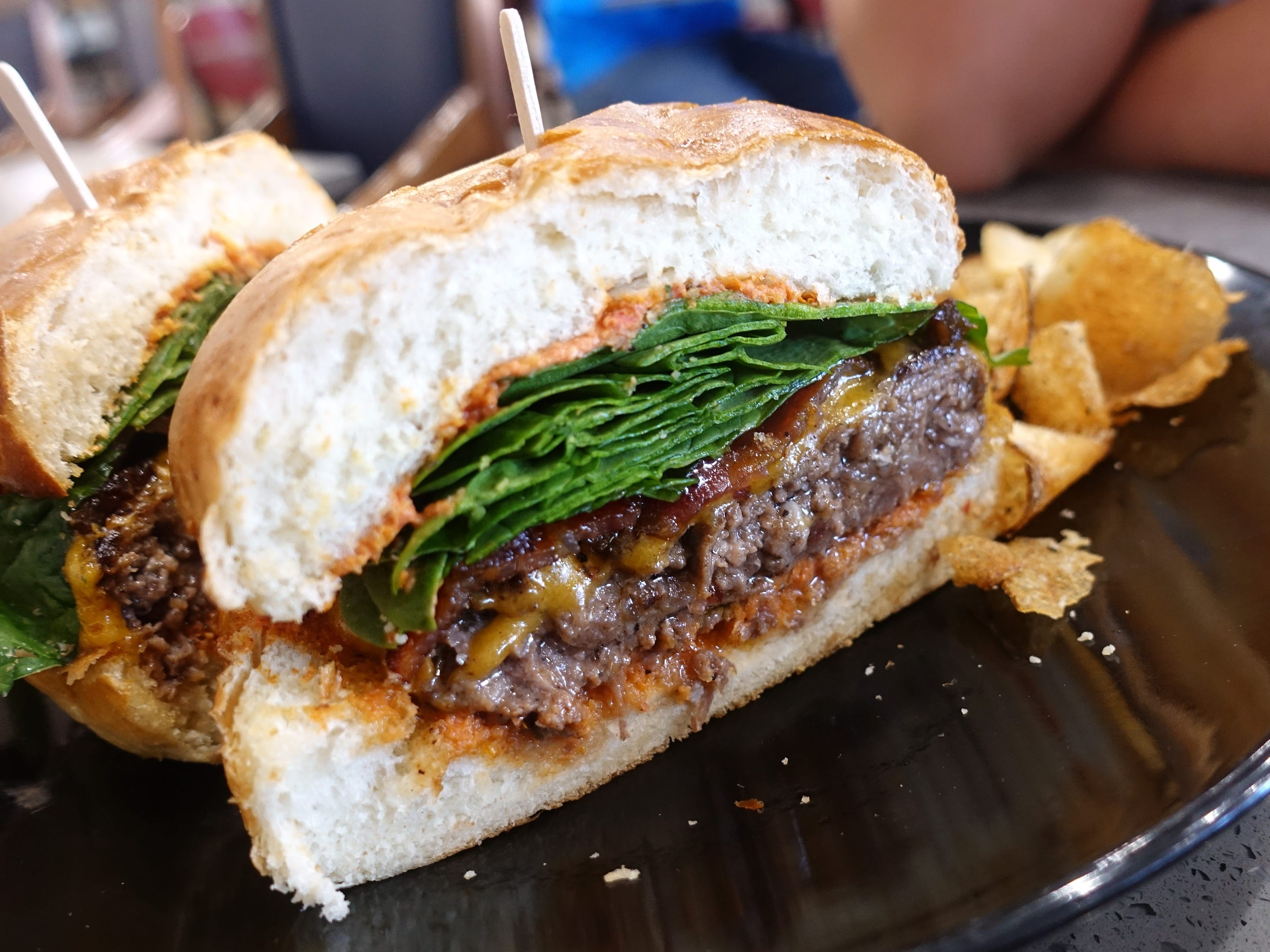 'The Obligatory Burger' with Angus patty, candied bacon, cheddar, spinach and super-secret sauce at Sweetest Season Artisan Eatery in Tempe.