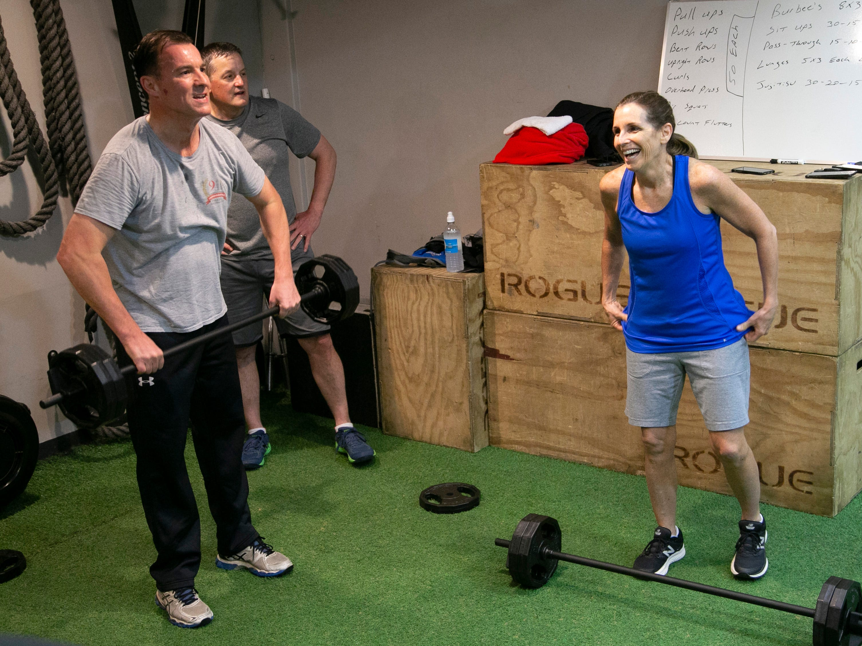 U.S. Senator Martha McSally, R.-Ariz., lifts (right) weights while exercising with other legislatures including U.S. Representatives Tom Suozzi, D-N.Y., (left) and Bruce Westerman, R-Ark., during a bipartisan workout group at 6 a.m. at a gym just outside the U.S. Capitol complex in Washington D.C. on Feb. 7, 2019.