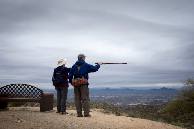 David Blakeslee (right) and Debra Hamilton (both winter visitors) view Phoenix from Buena Vista Outlook, Feb. 14, 2019, at South Mountain Park.