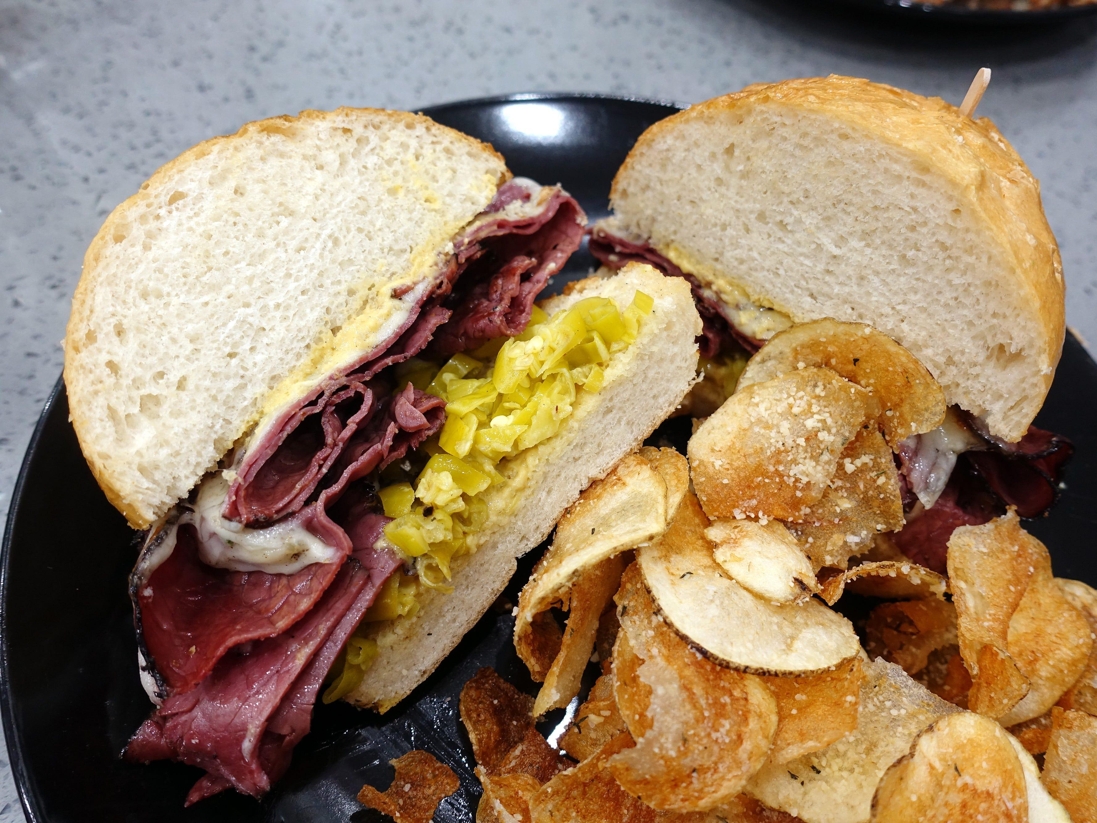 Hot pastrami sandwich with melted provolone, pepperoncini and spicy mustard at Sweetest Season Artisan Eatery in Tempe.