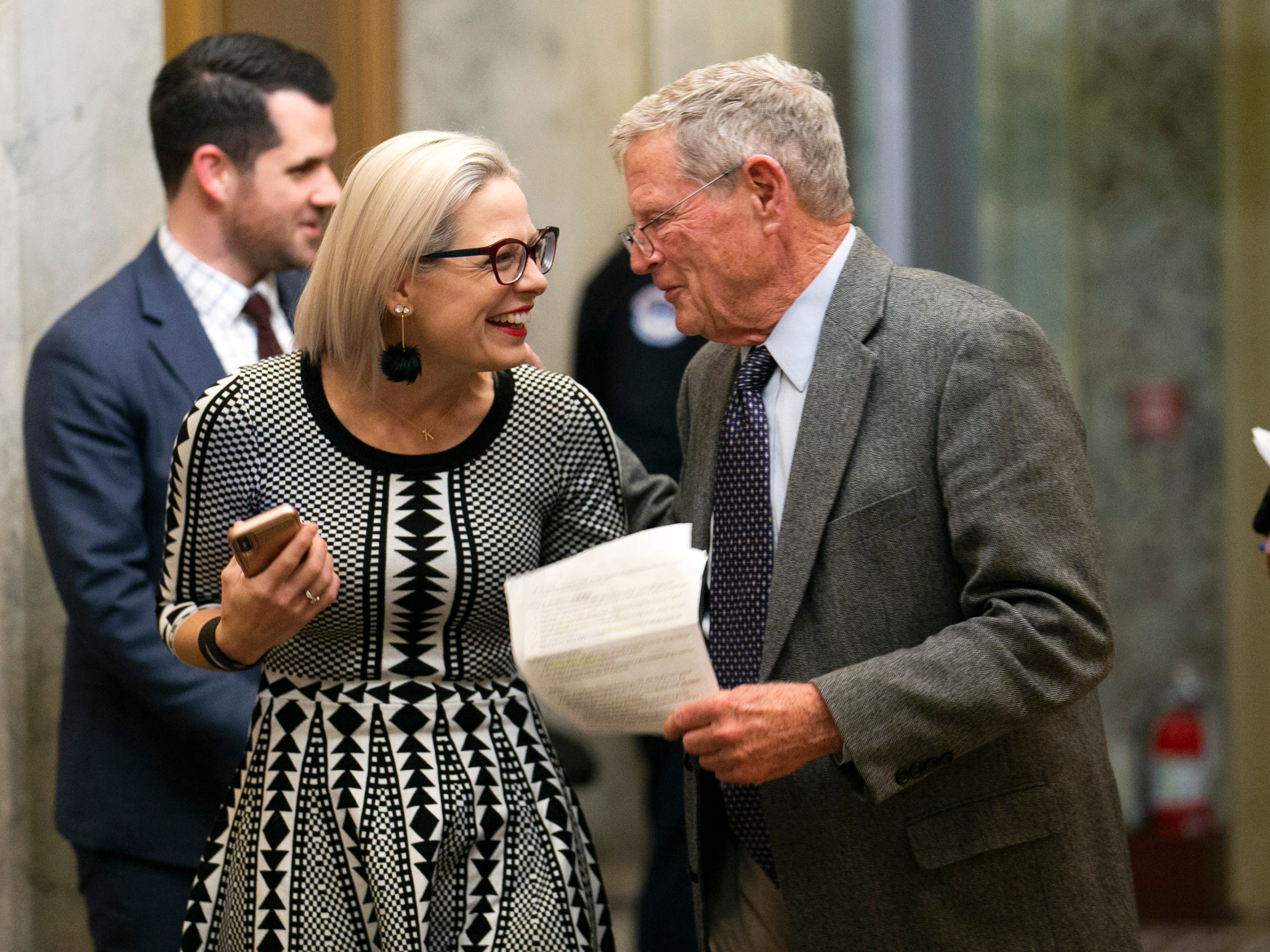 U.S. Senators Kyrsten Sinema, D.-Ariz., (left) and Jim Inhofe, R-Okla., share a moment after arriving in the U.S. Senate Building at the U.S. Capitol in Washington DC for a Monday night vote on Feb. 4, 2019.