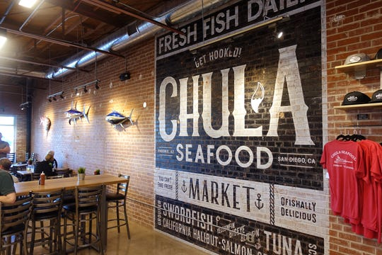 A wall mural inside Chula Seafood Uptown in Phoenix.