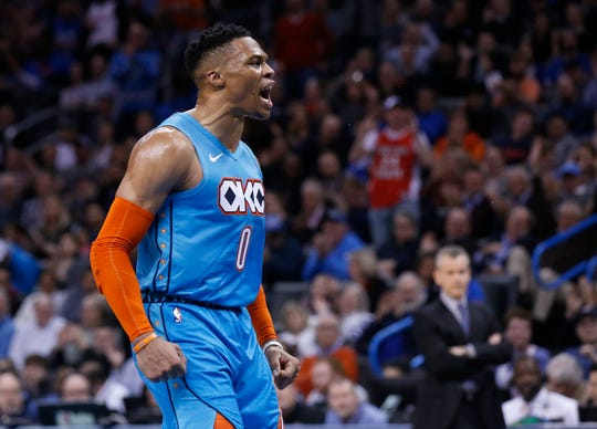Oklahoma City Thunder guard Russell Westbrook celebrates after a basket during the first half of the team's NBA basketball game against the Orlando Magic in Oklahoma City, Tuesday, Feb. 5, 2019. (AP Photo/Sue Ogrocki)