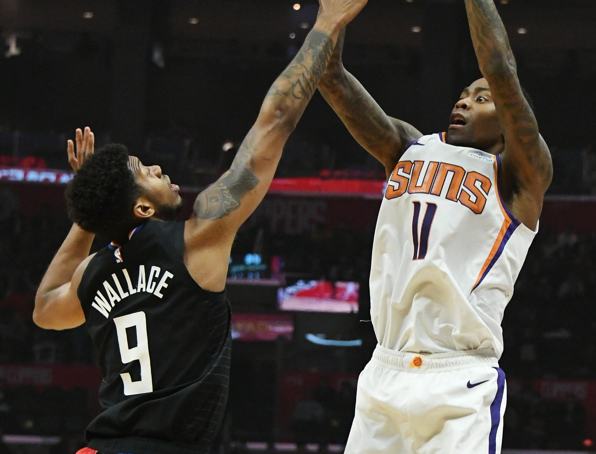 Feb 13, 2019; Los Angeles, CA, USA; Phoenix Suns guard Jamal Crawford (11) shoots over LA Clippers guard Tyrone Wallace (9) in the first half at Staples Center. Mandatory Credit: Richard Mackson-USA TODAY Sports