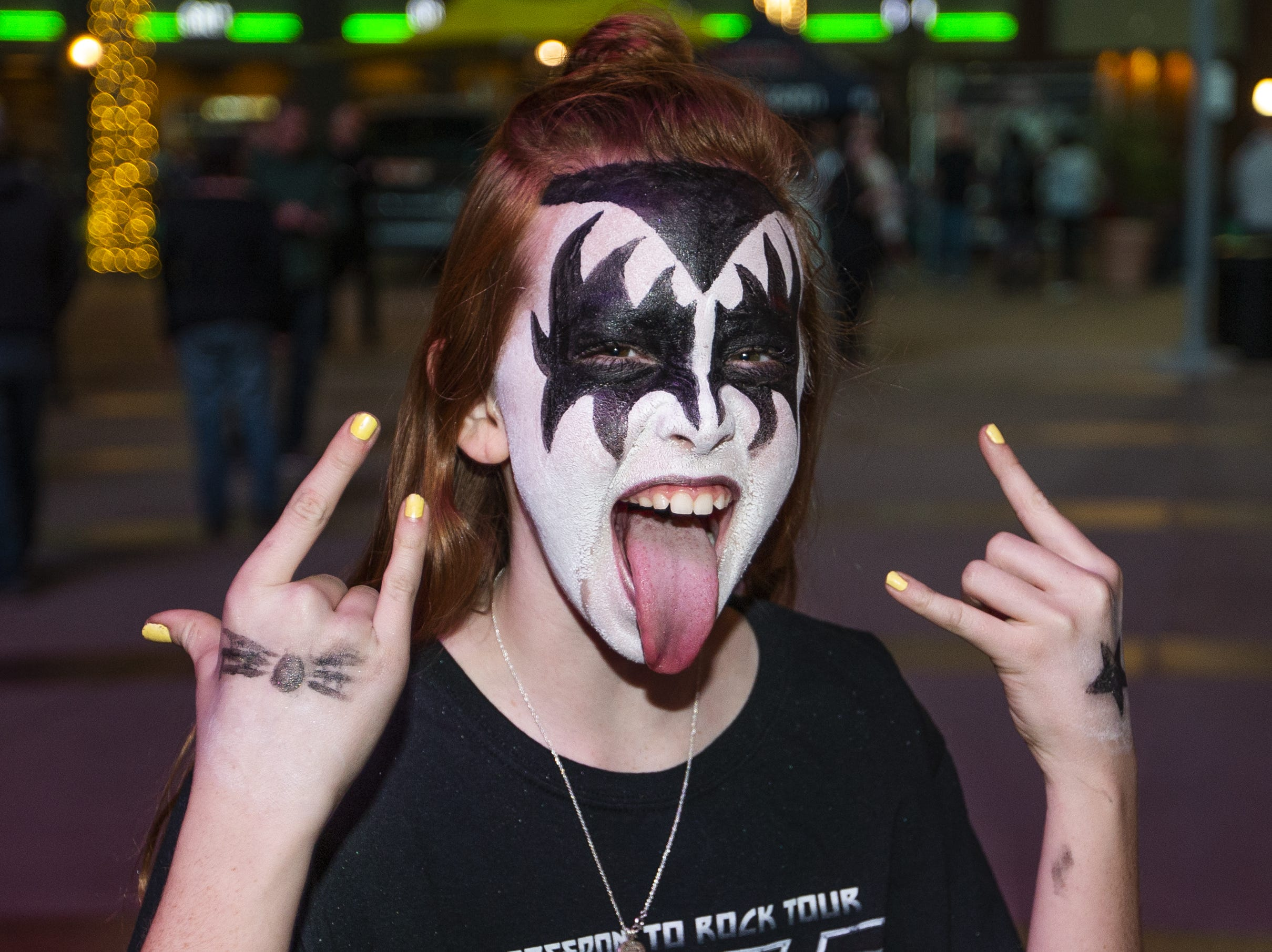 Madison Burgess, 11, of Peoria, shows off her best KISS makeup prior to the concert by the famed group at Gila River Arena in Glendale on Wednesday, Feb. 13, 2019.  The concert was part of the End of the Road World Tour, the band's farewell to the fans.