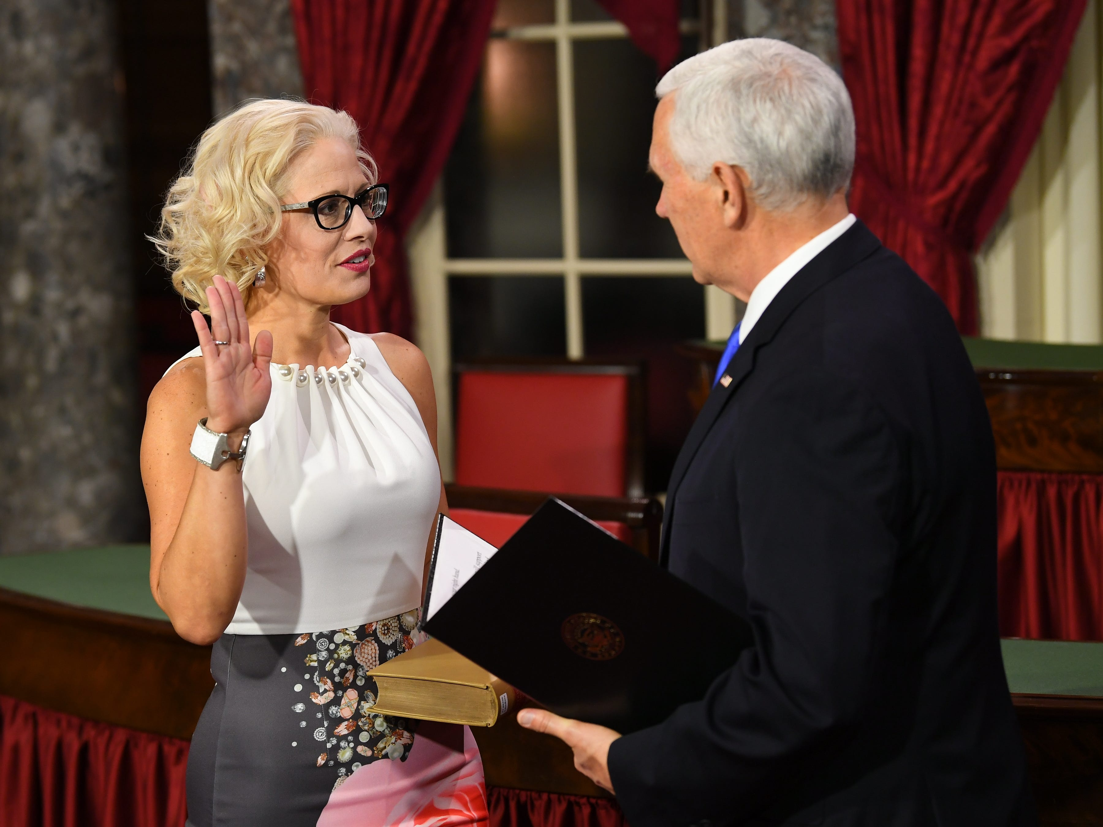 Vice President Mike Pence officiates ceremonial swearing of Senator Kyrsten Sinema, R.-Ariz., in the Old Senate Chambers at the U.S. Capitol.