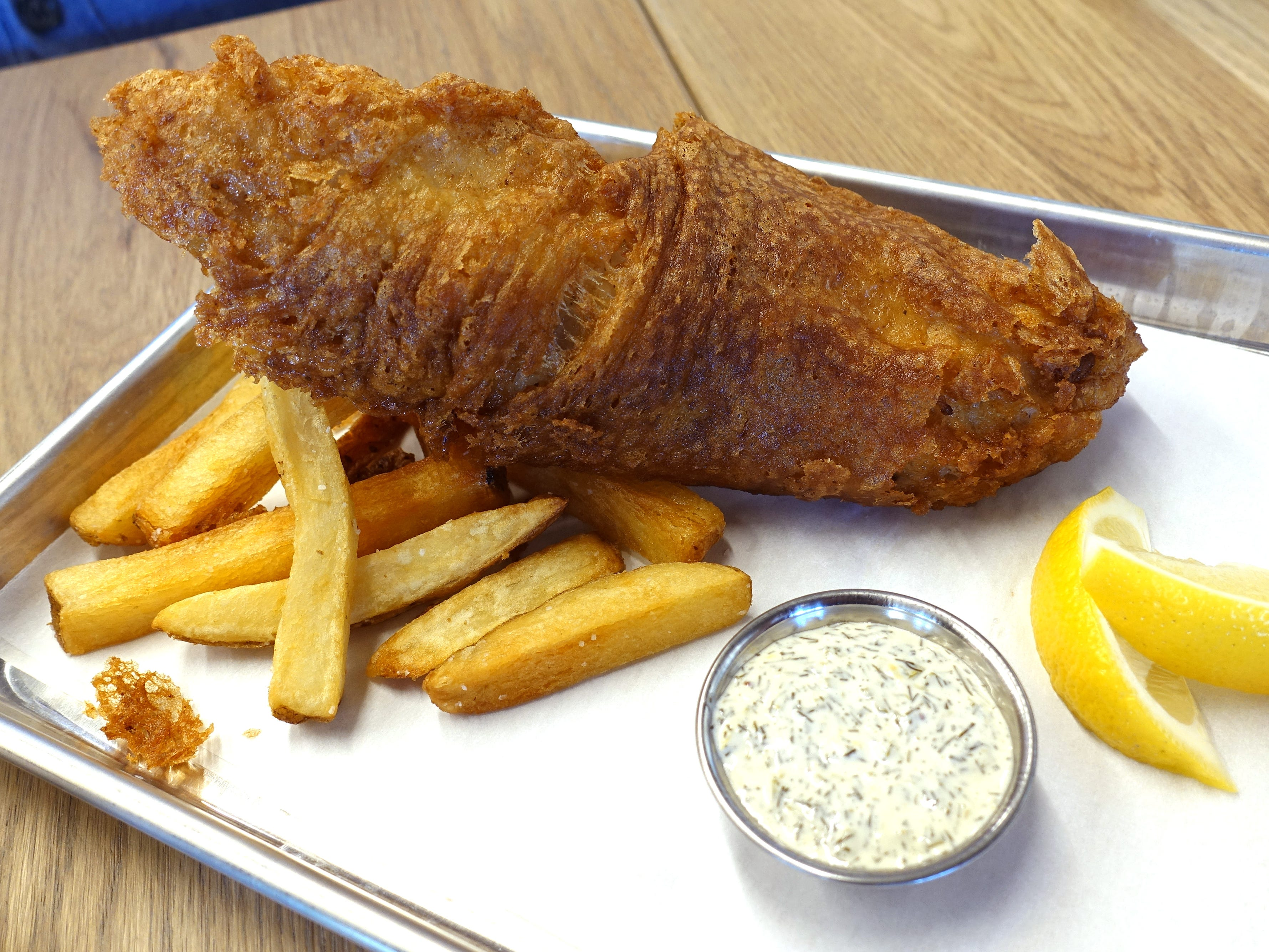 Fish and chips: battered and fried rockfish with Frites Street fries and dill tartar sauce at Chula Seafood Uptown in Phoenix.