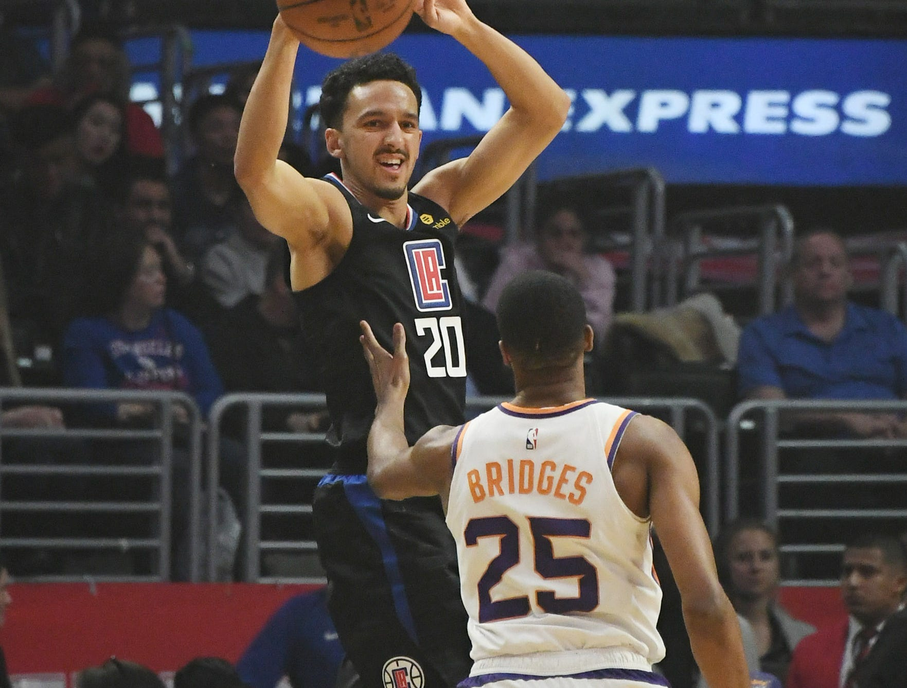 Feb 13, 2019; Los Angeles, CA, USA; LA Clippers guard Landry Shamet (20) passes the ball away from Phoenix Suns forward Mikal Bridges (25) in the first half at Staples Center. Mandatory Credit: Richard Mackson-USA TODAY Sports
