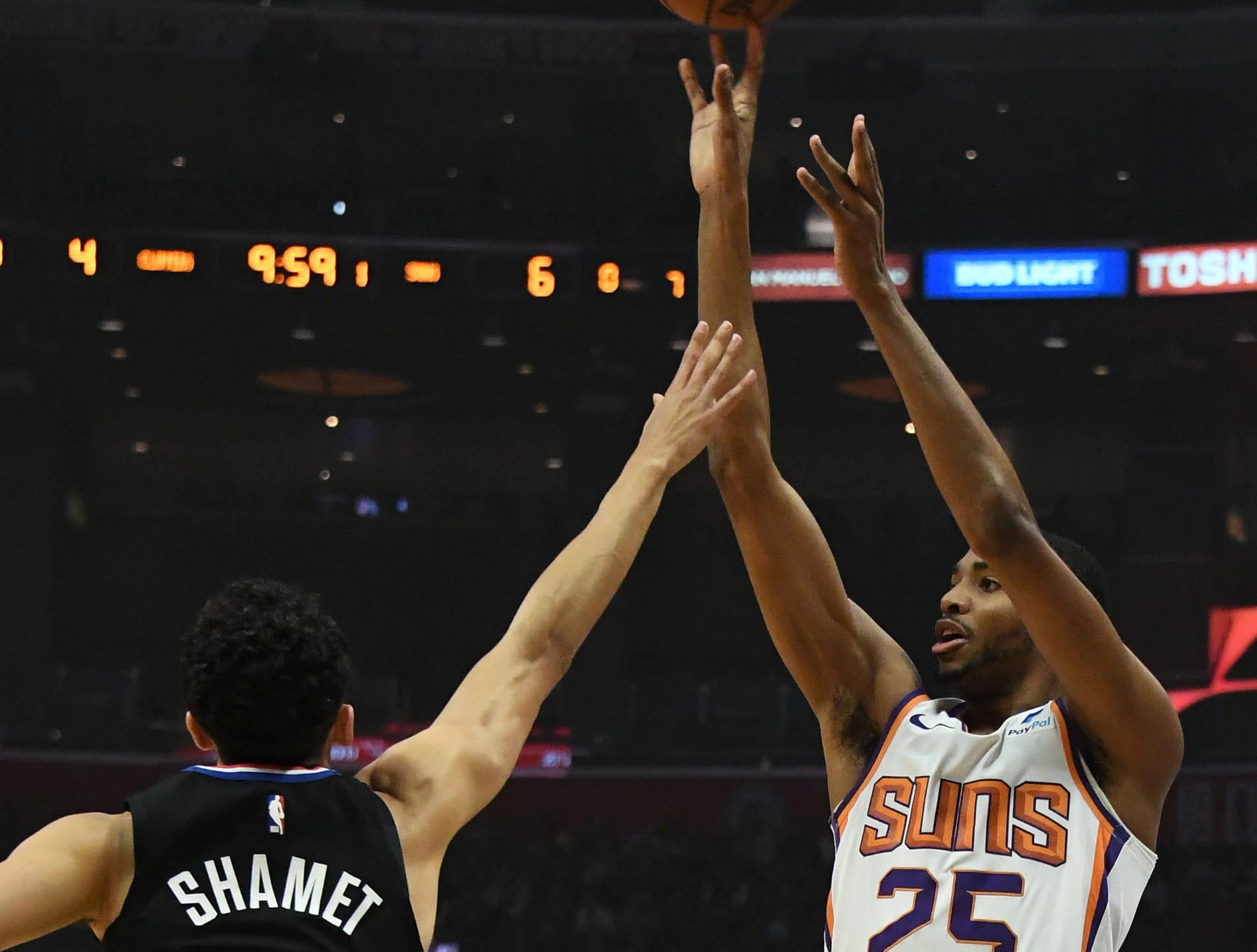 Feb 13, 2019; Los Angeles, CA, USA; Phoenix Suns forward Mikal Bridges (25) shoots over LA Clippers guard Landry Shamet (20) in the first half at Staples Center. Mandatory Credit: Richard Mackson-USA TODAY Sports