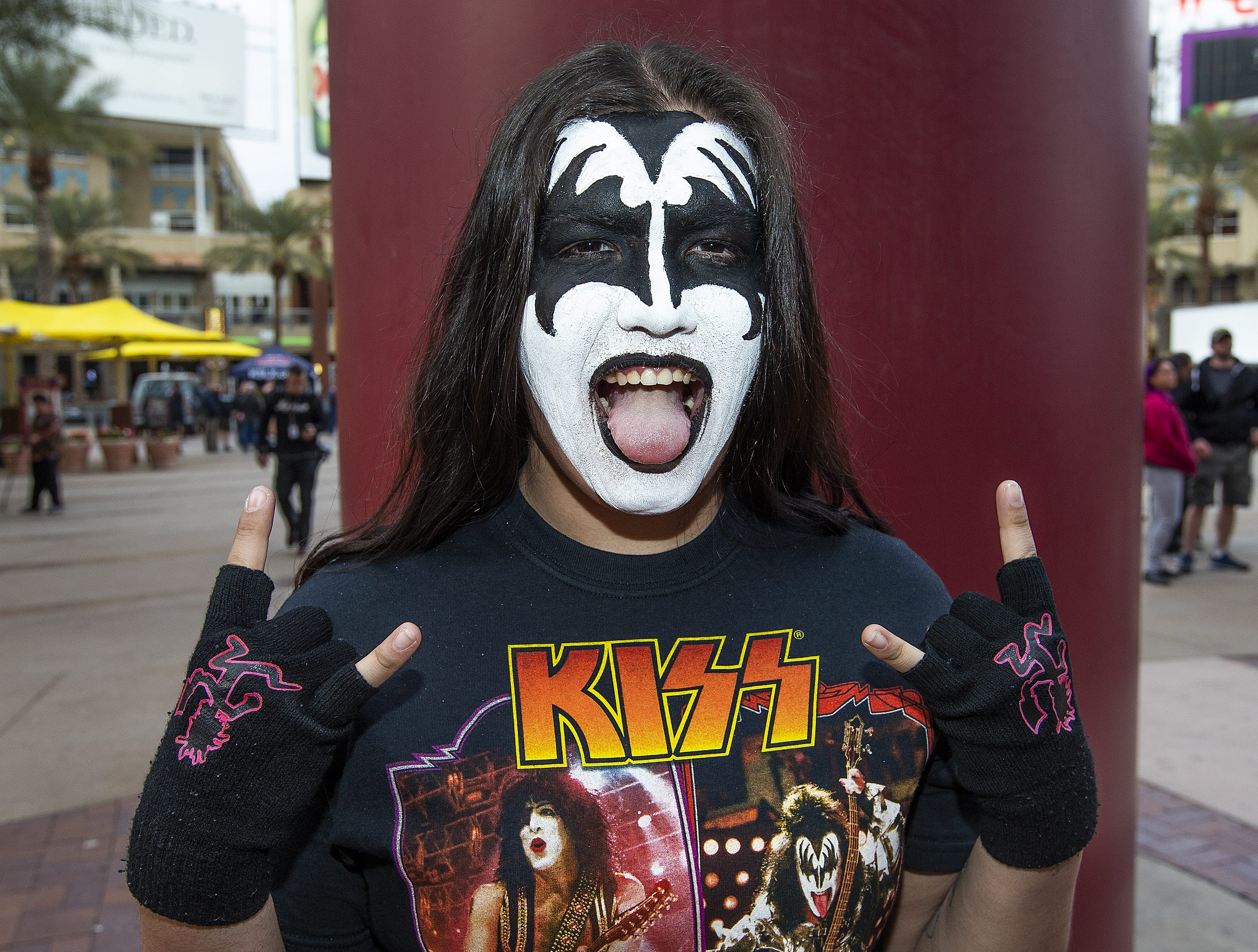 Angela Lozano, 19, of Phoenix, shows off her best KISS makeup prior to the concert by the famed group at Gila River Arena in Glendale on Wednesday, Feb. 13, 2019.  The concert was part of the End of the Road World Tour, the band's farewell to the fans.