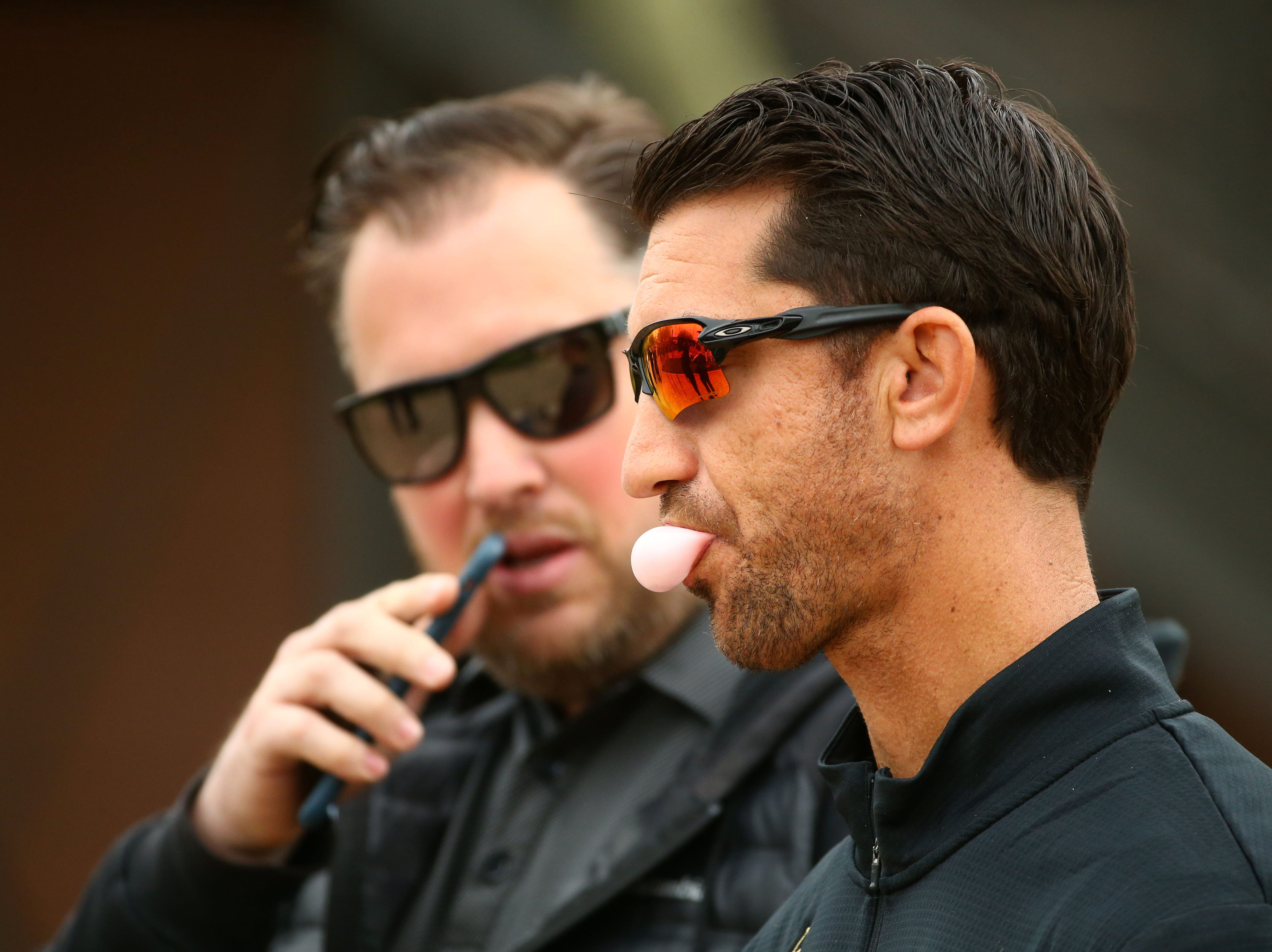 Arizona Diamondbacks general manager Mike Hazen blows a bubble during the first day of spring training workouts on Feb. 13 at Salt River Fields in Scottsdale.