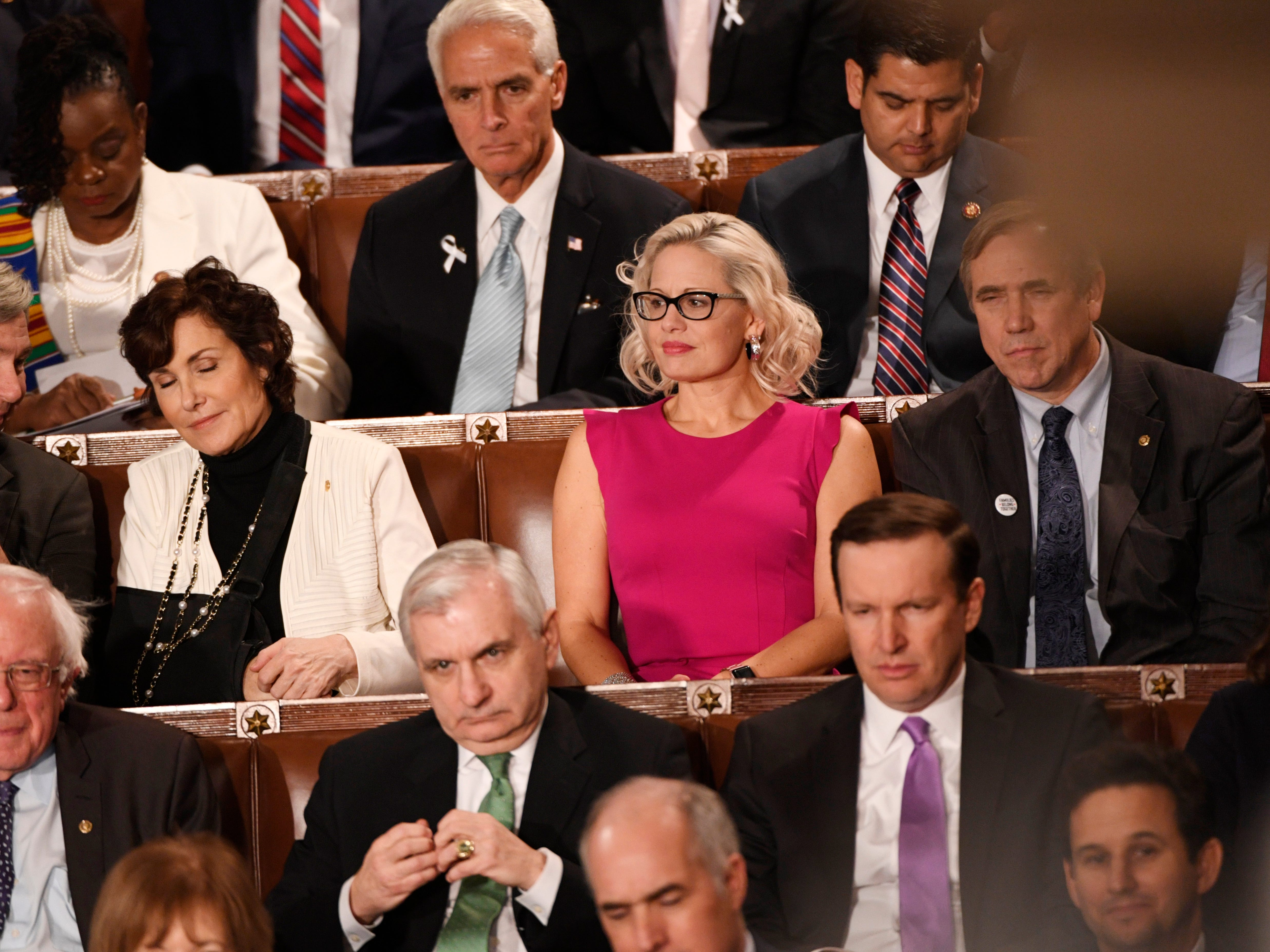 Feb 5, 2019; Washington, DC, USA;   Sen. Kyrsten Sinema (D-Ariz) listens to President Donald Trump delivers the State of the Union address from the House chamber of the United States Capitol in Washington.  Mandatory Credit: Jasper Colt-USA TODAY NETWORK (Via OlyDrop)