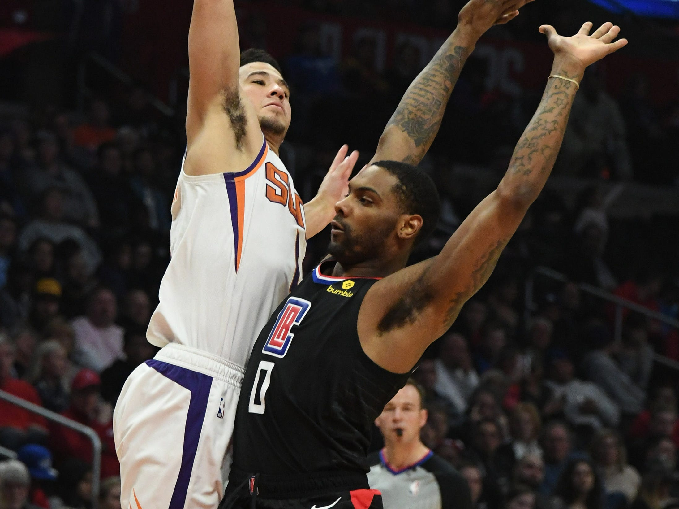 Feb 13, 2019; Los Angeles, CA, USA; Phoenix Suns guard Devin Booker (1) shoots against LA Clippers guard Sindarius Thornwell (0) in the first half at Staples Center. Mandatory Credit: Richard Mackson-USA TODAY Sports
