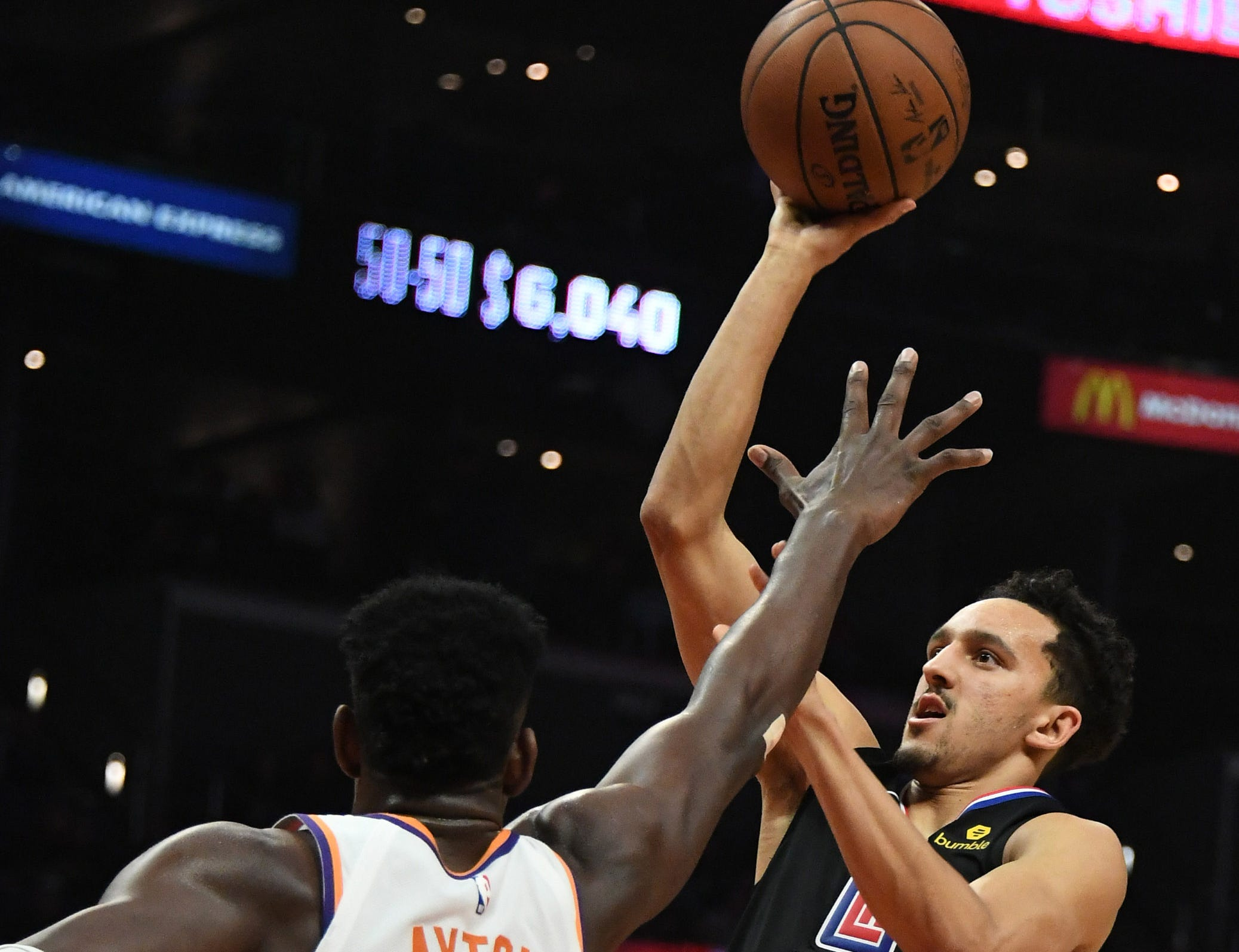 Feb 13, 2019; Los Angeles, CA, USA; LA Clippers guard Landry Shamet (20) shoots over Phoenix Suns center Deandre Ayton (22) in the second half at Staples Center. Mandatory Credit: Richard Mackson-USA TODAY Sports