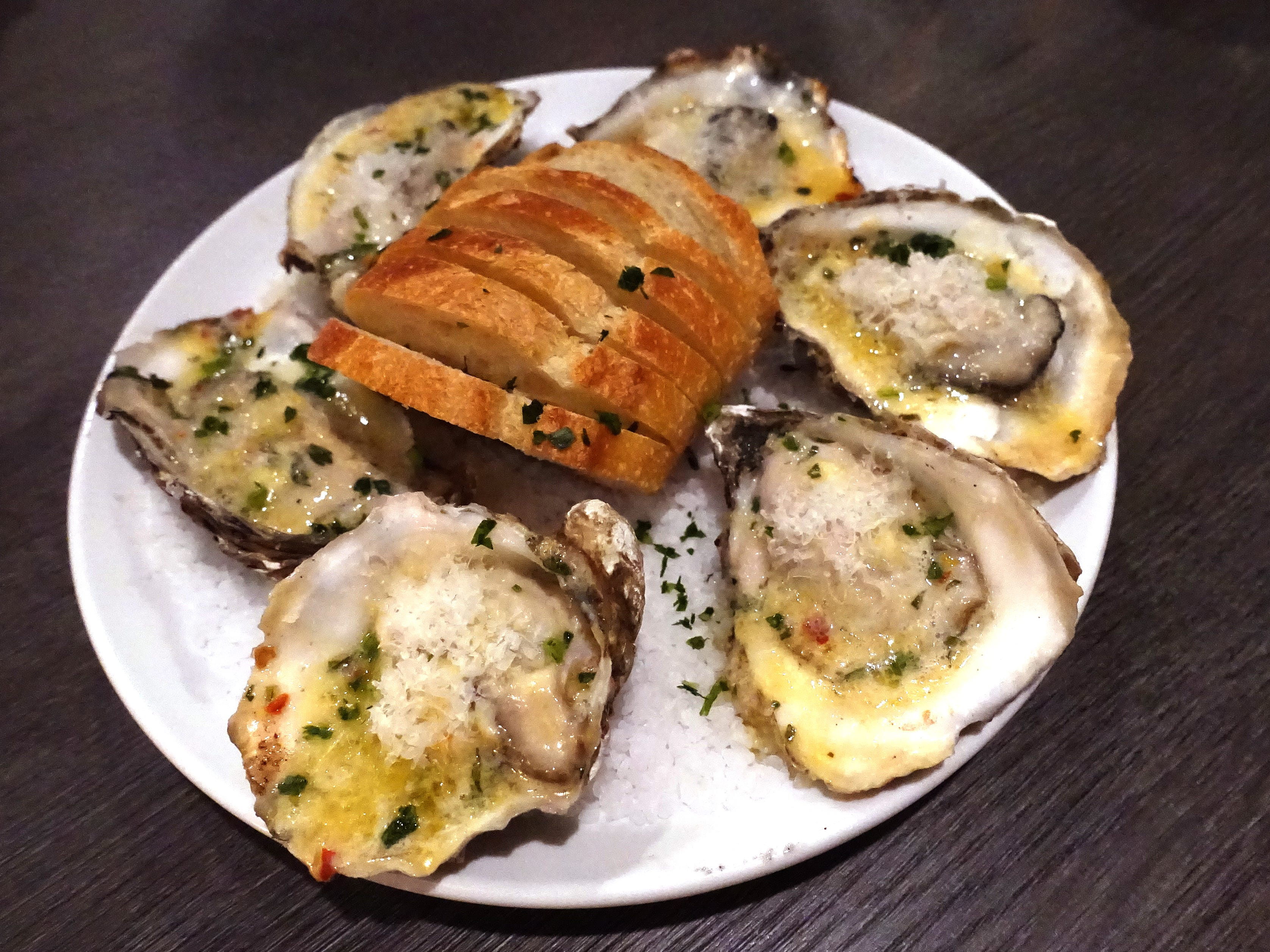 Grilled Blue Point oysters with Cutino butter sauce and Grana Padano at Hush Public House in Scottsdale.