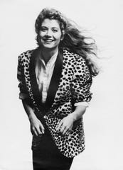 "Amy Grant and the iconic leopard-print jacket that she sports on the cover of 1985's ""Unguarded."""
