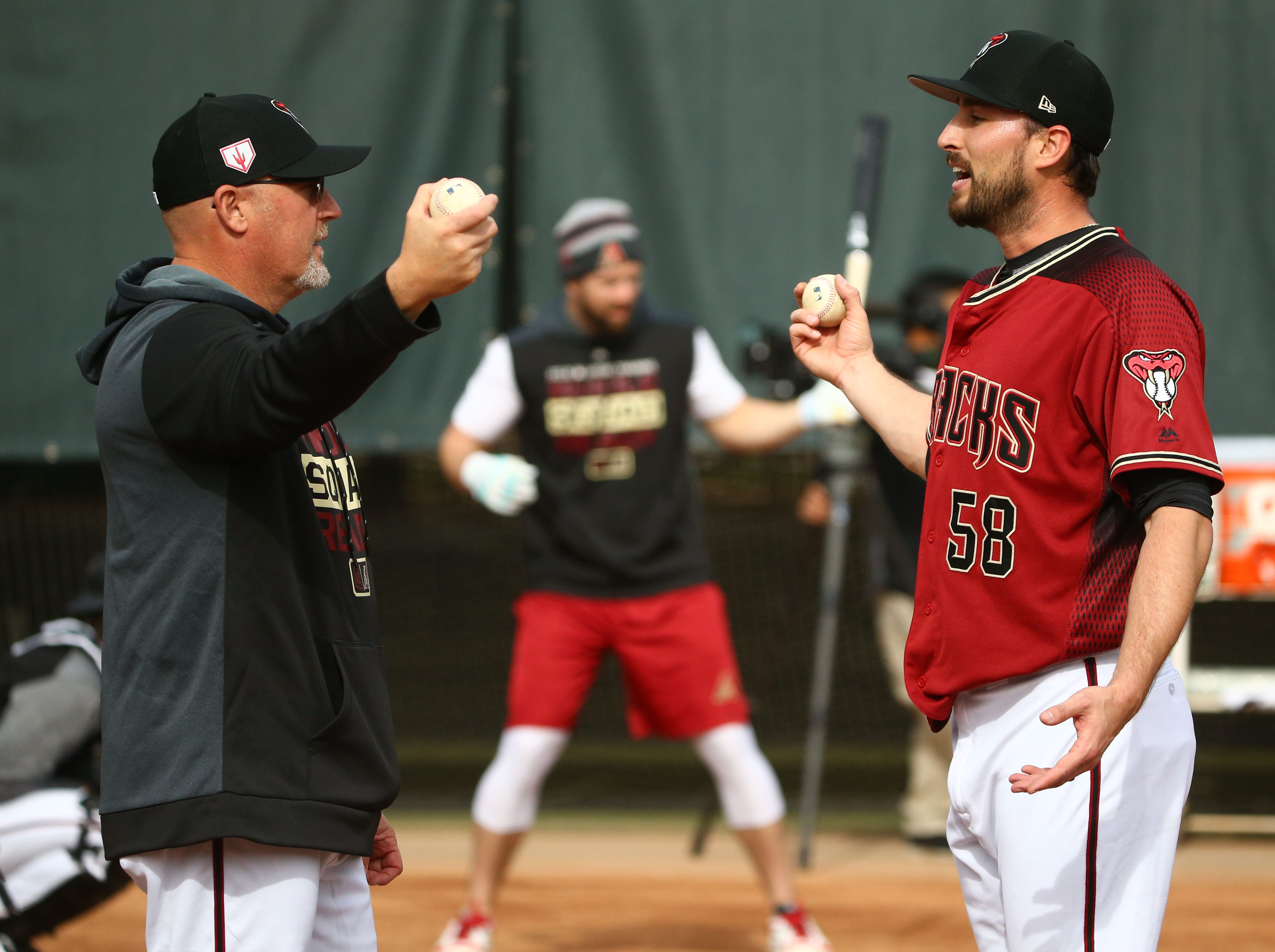 Arizona Diamondbacks pitcher Stefan Crichton takls to pitching coach Mike Butcher during the first day of spring training workouts on Feb. 13 at Salt River Fields in Scottsdale.