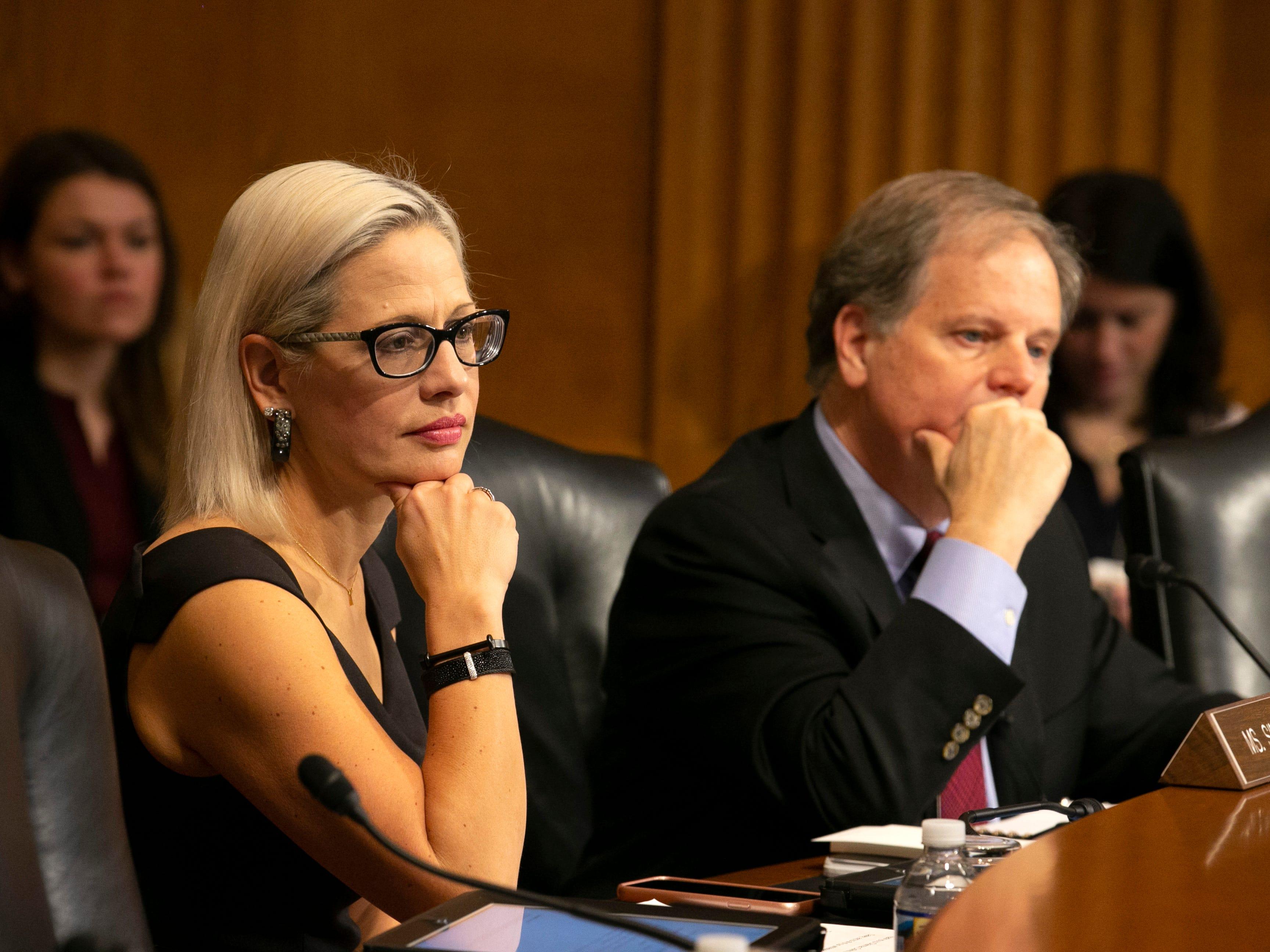 U.S. Sen. Kyrsten Sinema, D-Ariz., listens alongside U.S. Sen. Doug Jones, D-Ala., during the U.S. Senate Special Committee on Aging at the U.S. Capitol in Washington, D.C., on Feb. 6, 2019.