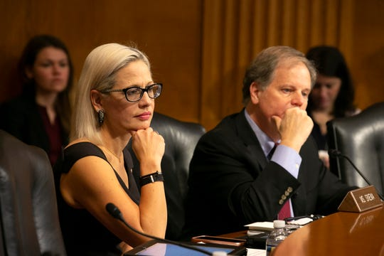 U.S. Sen. Kyrsten Sinema, D-Ariz., listens alongside U.S. Sen. Doug Jones, D-Ala., during the U.S. Senate Special Committee on Aging at the U.S. Capitol in Washington, D.C., on Feb. 6, 2019.