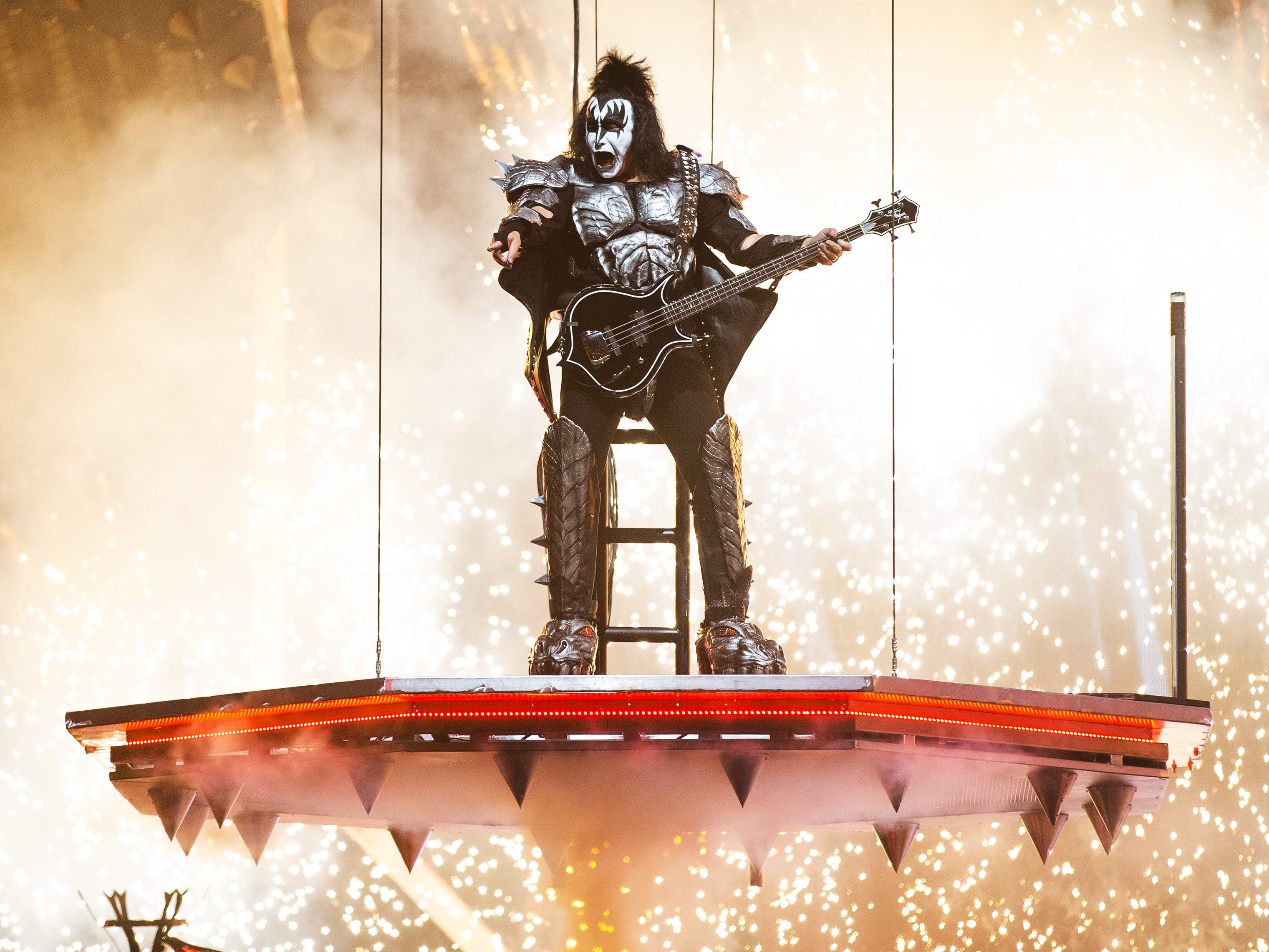 "Gene Simmons of Kiss descends during the opening number, ""Detroit Rock City,"" at Gila River Arena during the End of the Road World Tour stop in Glendale, Wednesday, Feb. 13, 2019. Thousands of fans came to see the band's farewell concert."