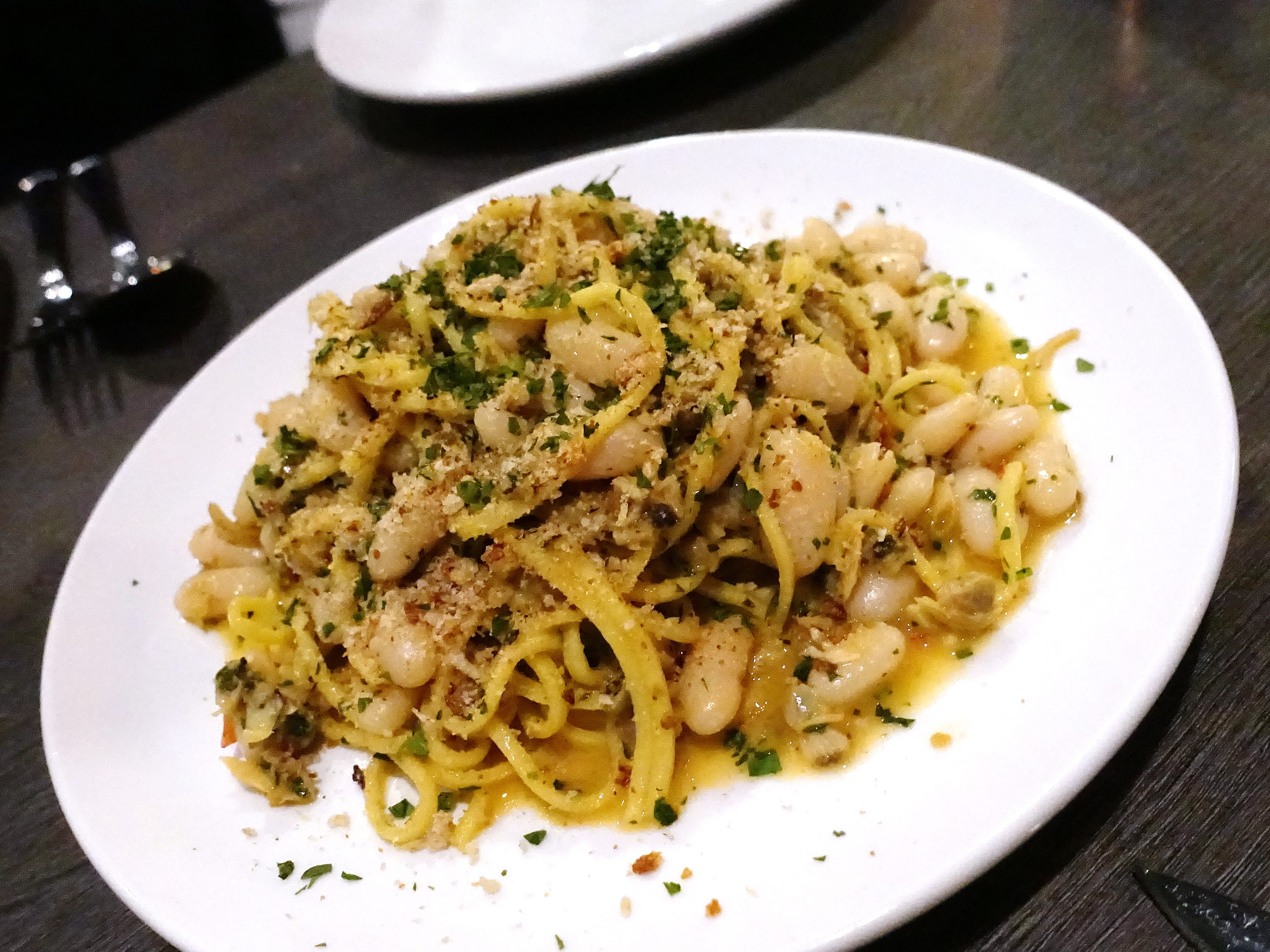 Spaghetti alla chitarra with clams, cannellini beans, fermented chile and breadcrumbs at Hush Public House in Scottsdale.