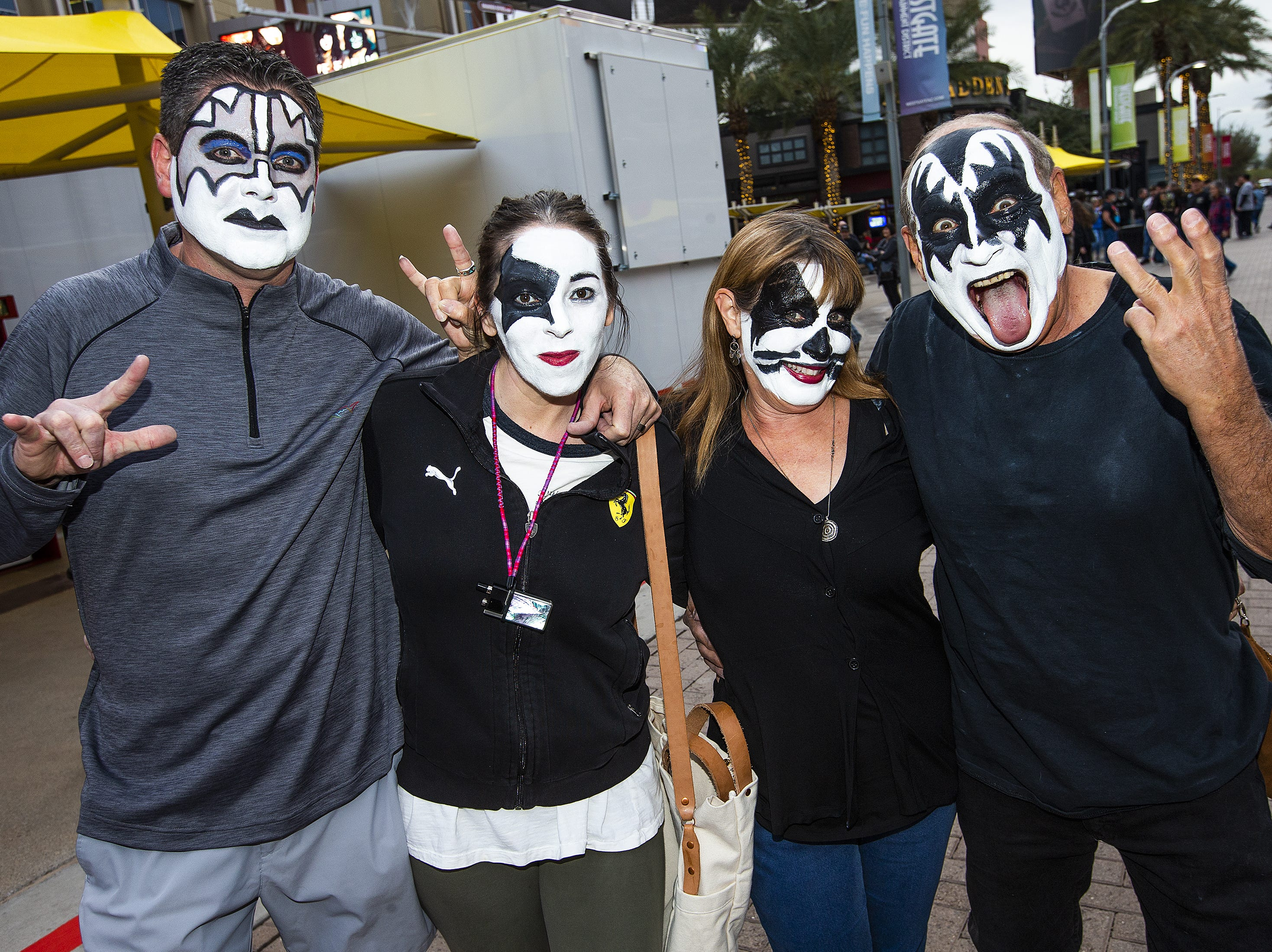 Couples Russ Clark, 47, and Sara Clark, 38, with Judy Morrow, 66, and Dave Lodiko, 70, show off their best KISS makeup prior to the concert by the famed group at Gila River Arena in Glendale on Wednesday, Feb. 13, 2019.  The concert was part of the End of the Road World Tour, the band's farewell to the fans.