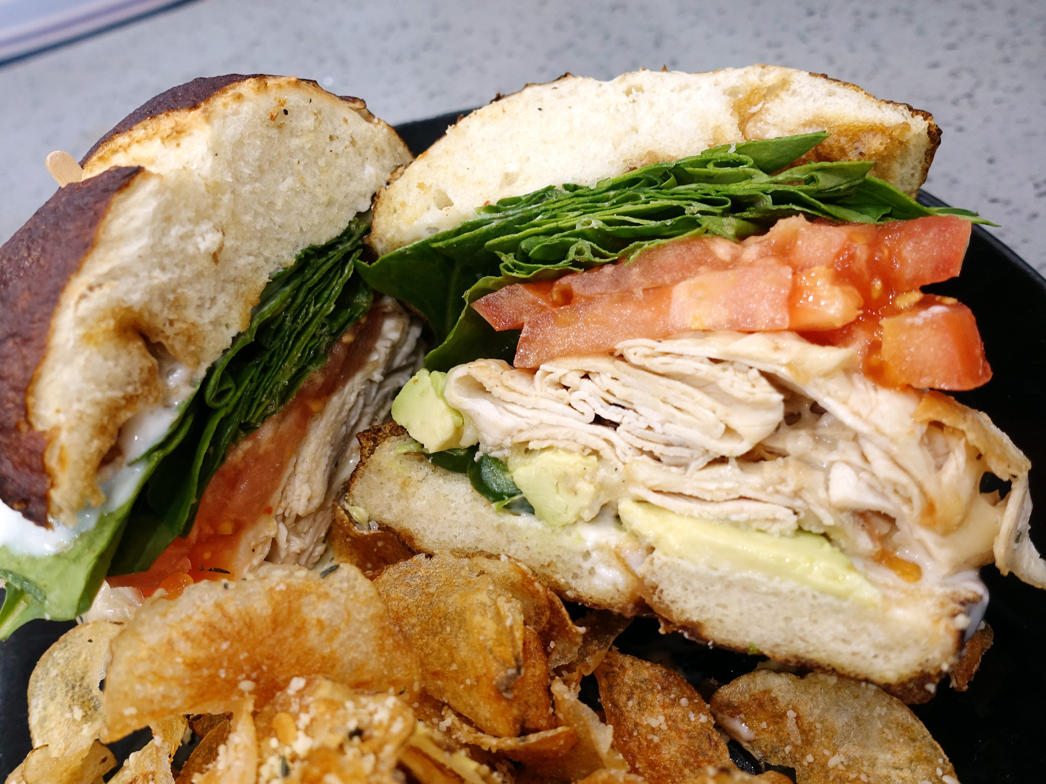 Hot chick sandwich with carved chicken breast, smoked mozzarella, ranch, spinach, tomato, avocado and jalapenos at Sweetest Season Artisan Eatery in Tempe.