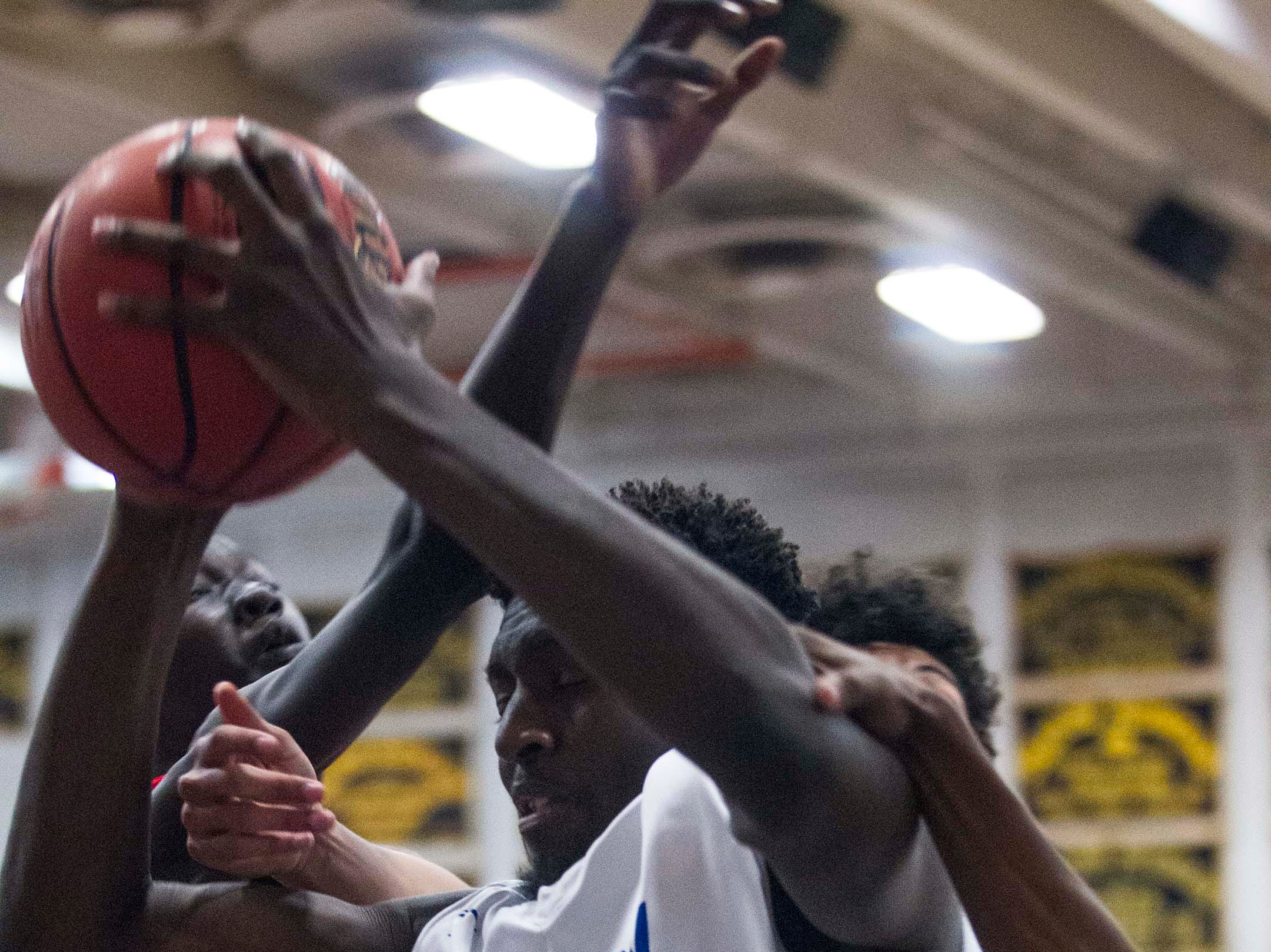 Shadow Mountain's Malik Lamin (44) pulls down a rebound against Moon Valley during the second half of their game in Phoenix, Tuesday, Feb .12,  2019.