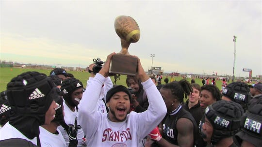 Baron Flenory, who founded Pylon 7-on-7 13 years ago, hands out the trophy to 2020 Elite, a team made up of some of the state's top 2020 prospects, including Kelee Ringo, Bijan Robinson and Lathan Ransom.