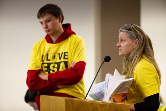 Kathy Visser, of Scottsdale, speaks in favor of ESA during a hearing on school vouchers in a senate hearing room at the state Capitol in Phoenix on February 13.