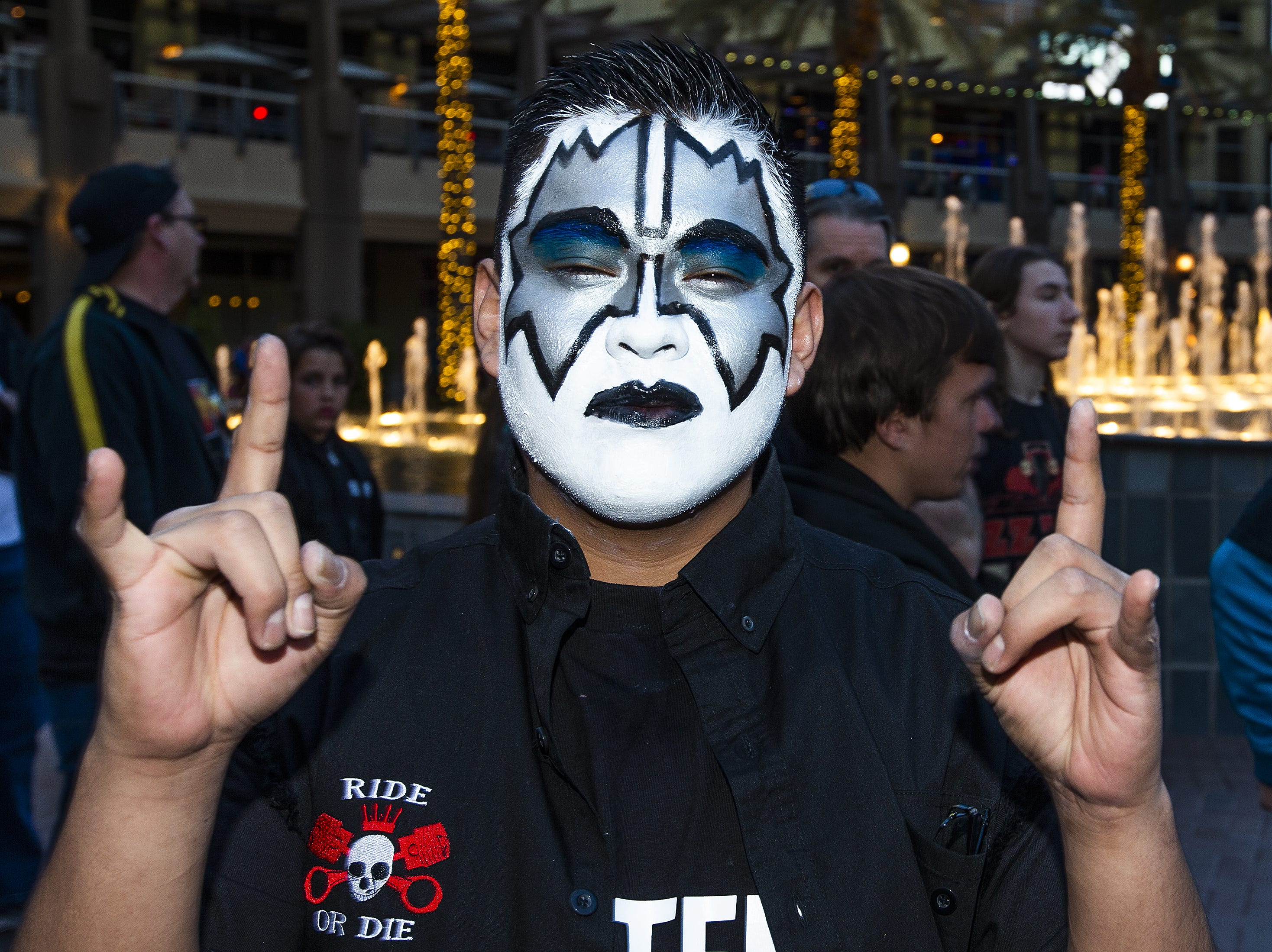 Jackson Tsosie, 25, of Glendale shows off his best KISS makeup prior to the concert by the famed group at Gila River Arena in Glendale on Wednesday, Feb. 13, 2019.  The concert was part of the End of the Road World Tour, the band's farewell to the fans.