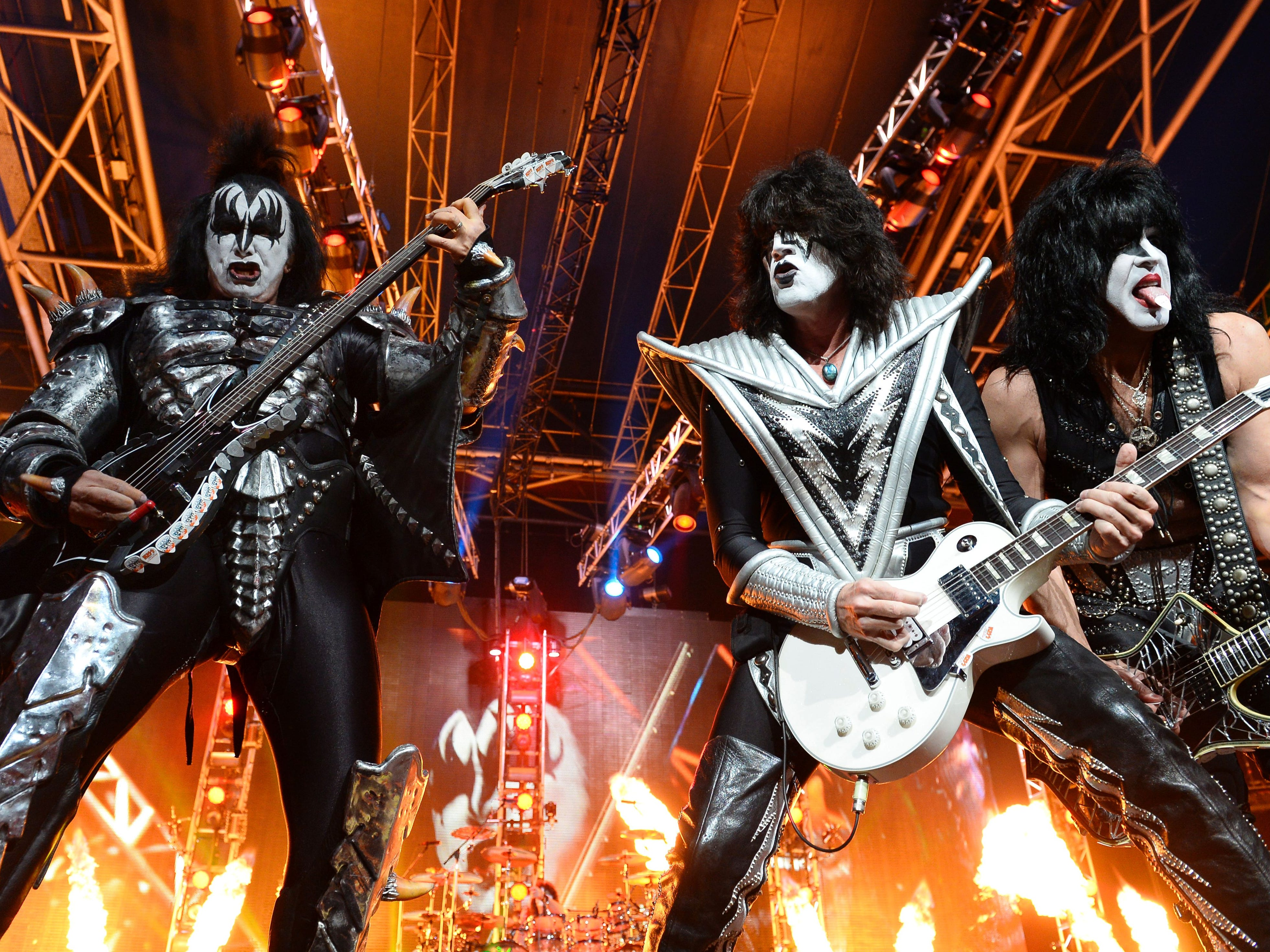 Bass guitarist Gene Simmons (L), guitarist Tommy Thayer (C) and singer and guitarist Paul Stanley (R) of US rock band Kiss perform on stage at the Zenith in Paris on June 16, 2015/AFP PHOTO BERTRAND GUAY / AFP / BERTRAND GUAY        (Photo credit should read BERTRAND GUAY/AFP/Getty Images)