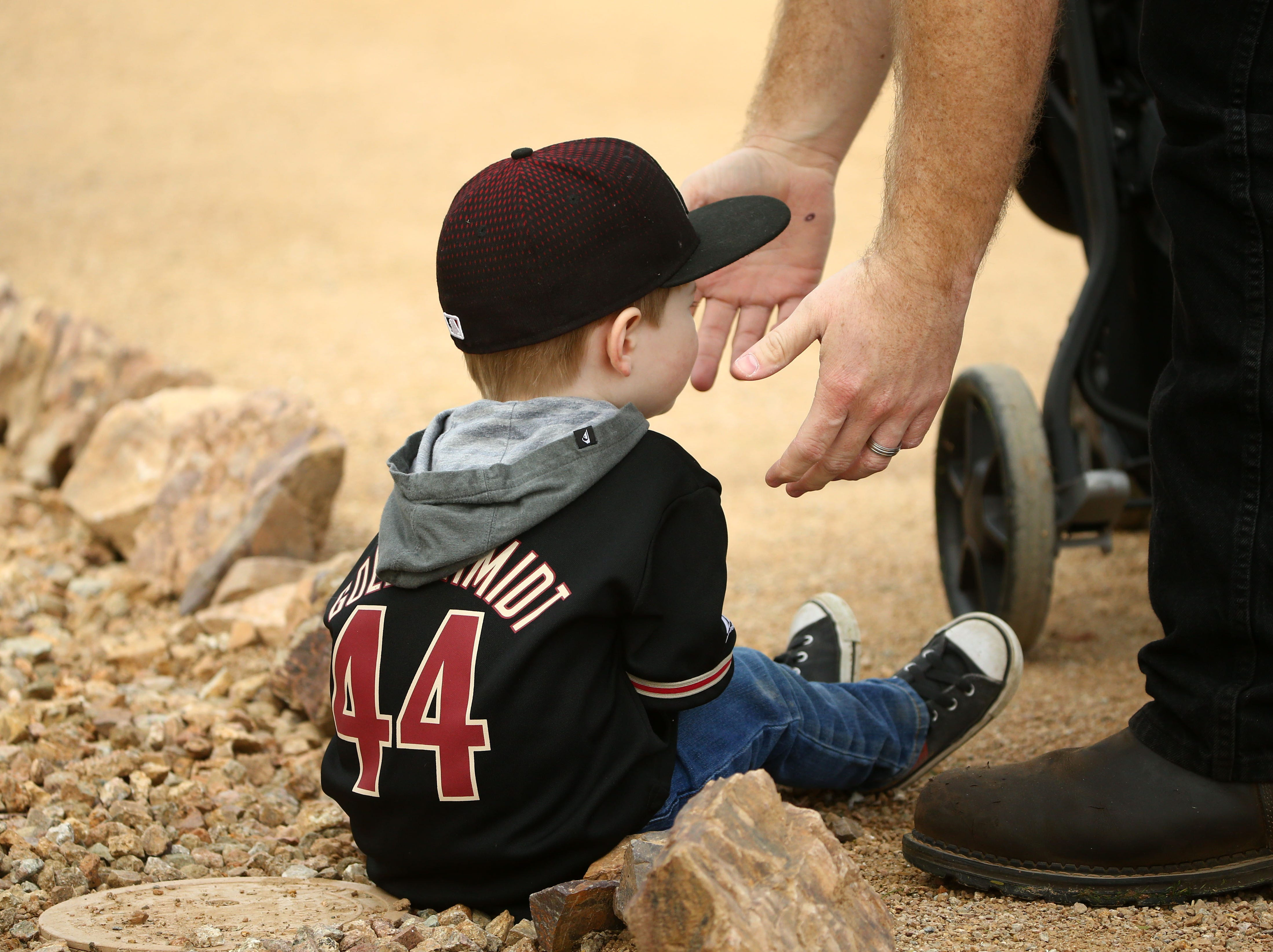 Jack Betts, age-3 of Phoenix wears his Paul Goldschmidt jersey during the first day of spring training workouts for the Arizona Diamondbacks on Feb. 13 at Salt River Fields in Scottsdale.