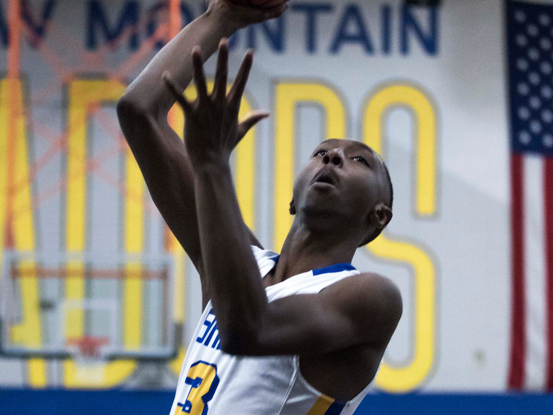 Shadow Mountain's Devontes Cobbs (3) eyes the basket against Moon Valley during the first half of their game in Phoenix, Tuesday, Feb .12,  2019.