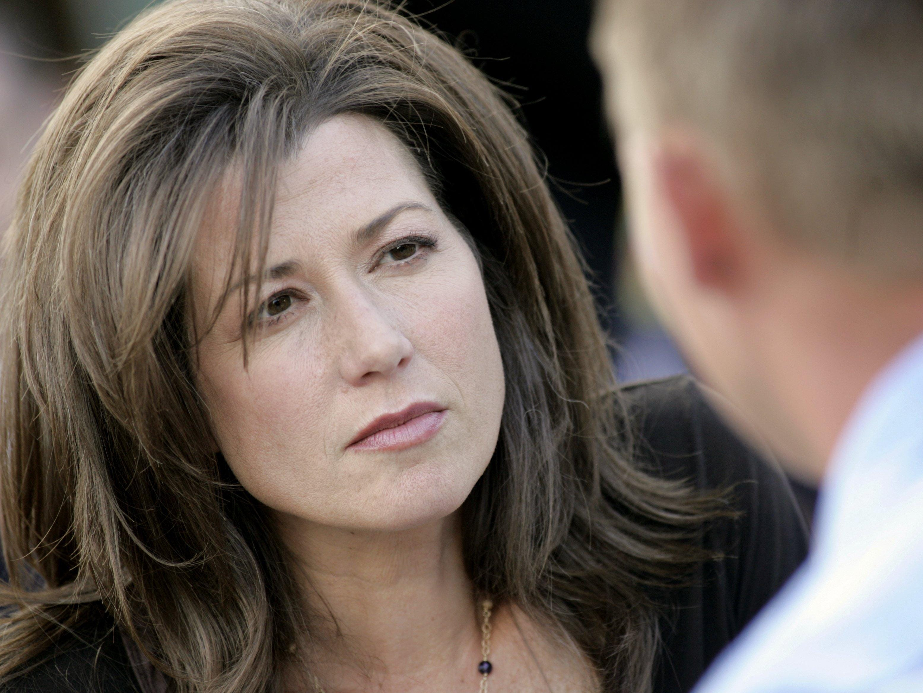 "Amy Grant listens to a wish during the taping of ""Three Wishes"" on Aug. 22, 2005."