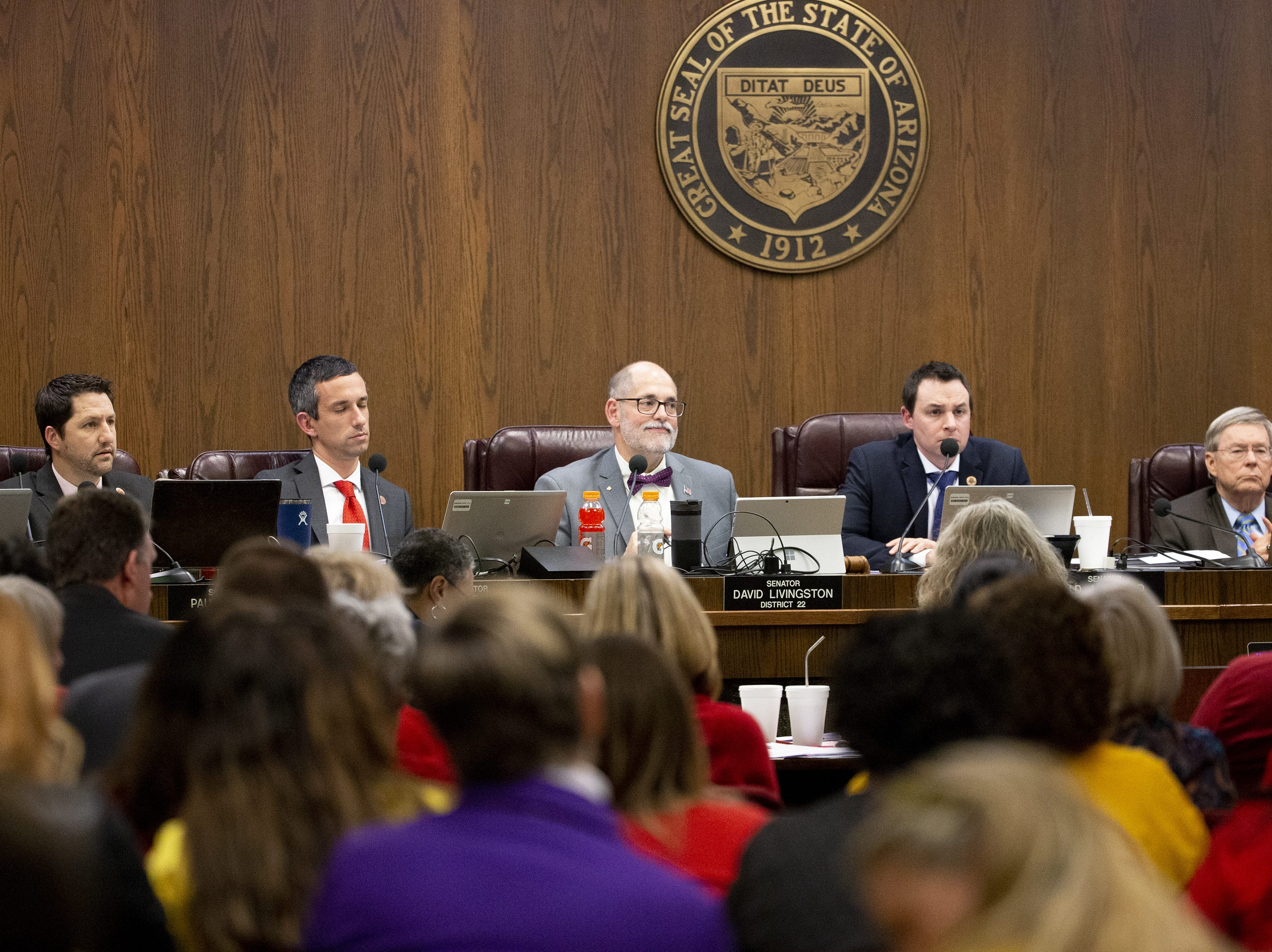 Members of the senate finance committee listen during a hearing on school vouchers in a senate hearing room at the state Capitol in Phoenix on February 13.