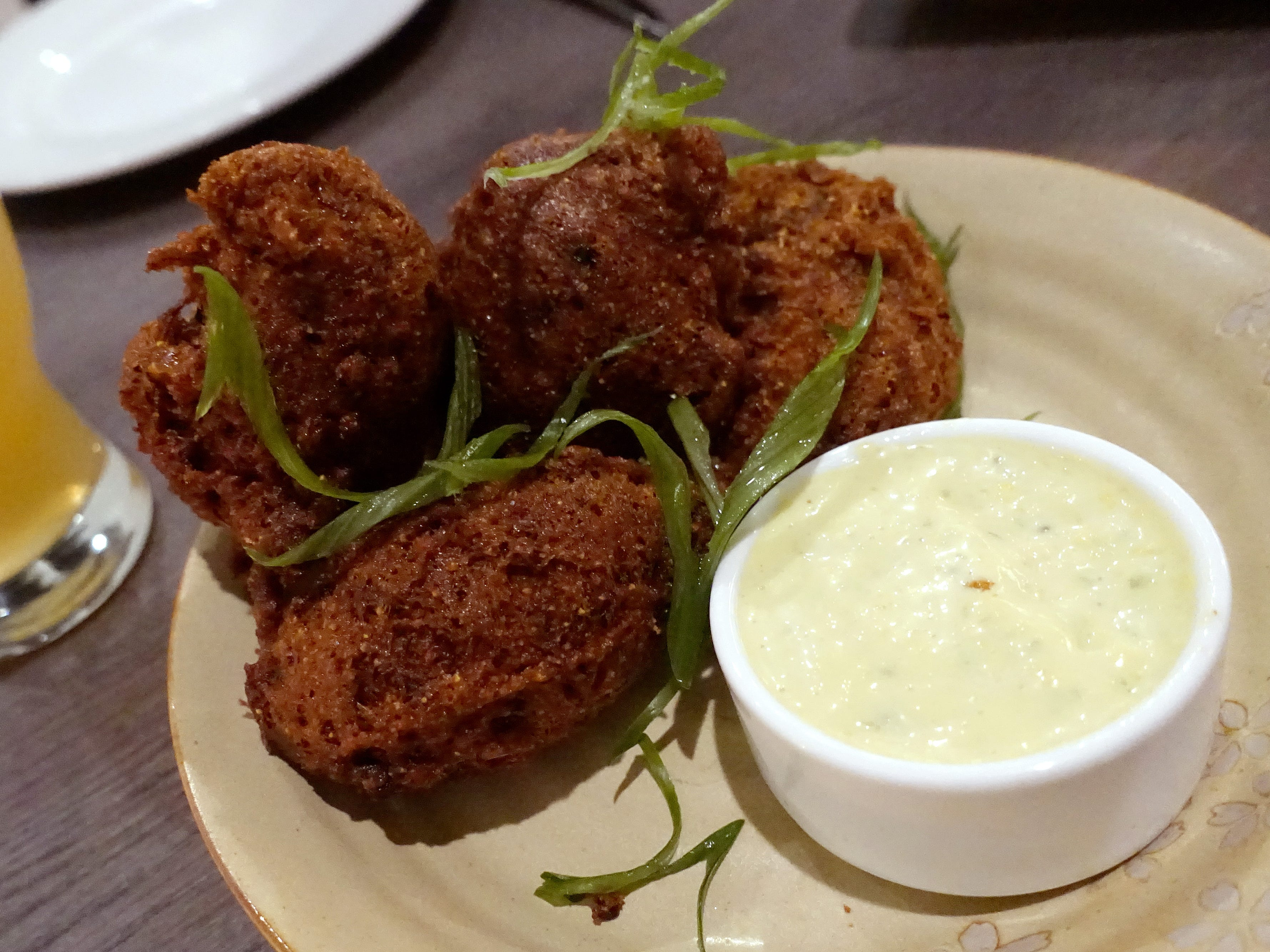 Crab hush puppies with sweet corn remoulade and scallions at Hush Public House in Scottsdale.
