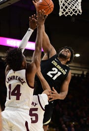 Feb 13, 2019; Boulder, CO, USA; Colorado Buffaloes forward Evan Battey (21) shoots over Arizona State Sun Devils forward Kimani Lawrence (14) and forward Taeshon Cherry (35) in the first half at the CU Events Center. Mandatory Credit: Ron Chenoy-USA TODAY Sports