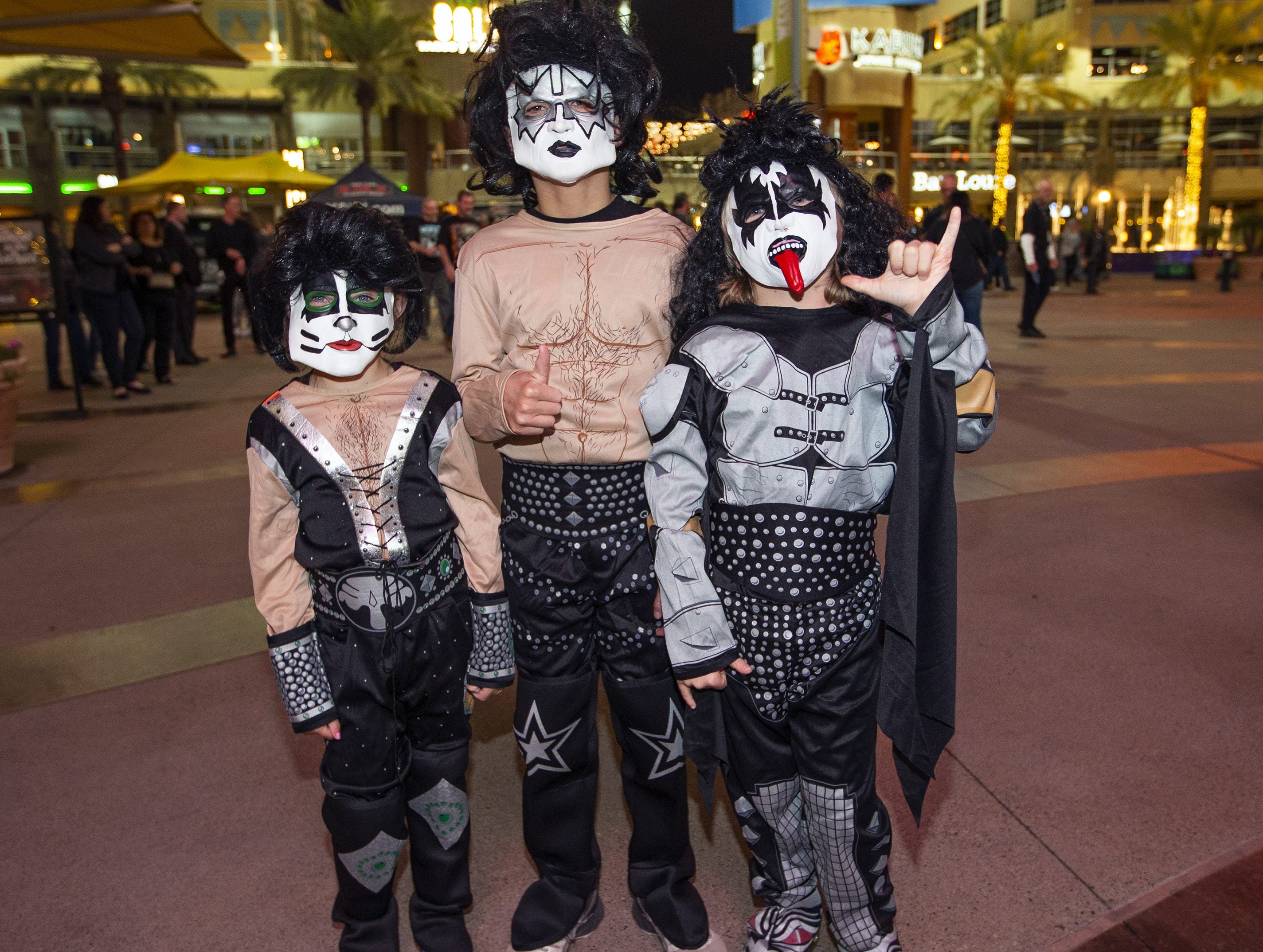(from left to right) Cave Creek siblings Avery Hamilton, 5; Torin, 10; and Brock, 7, show off their best KISS makeup prior to the concert by the famed group at Gila River Arena in Glendale on Wednesday, Feb. 13, 2019.  The concert was part of the End of the Road World Tour, the band's farewell to the fans.