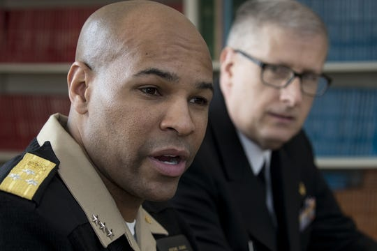 U.S. Surgeon General Jerome Adams (left) answers questions during an interview, February 13, 2019, at the Phoenix Indian Medical Center, 4212 N. 16th St., Phoenix. Looking on is Indian Health Service Chief Medical Officer Rear Admiral Michael Toedt.