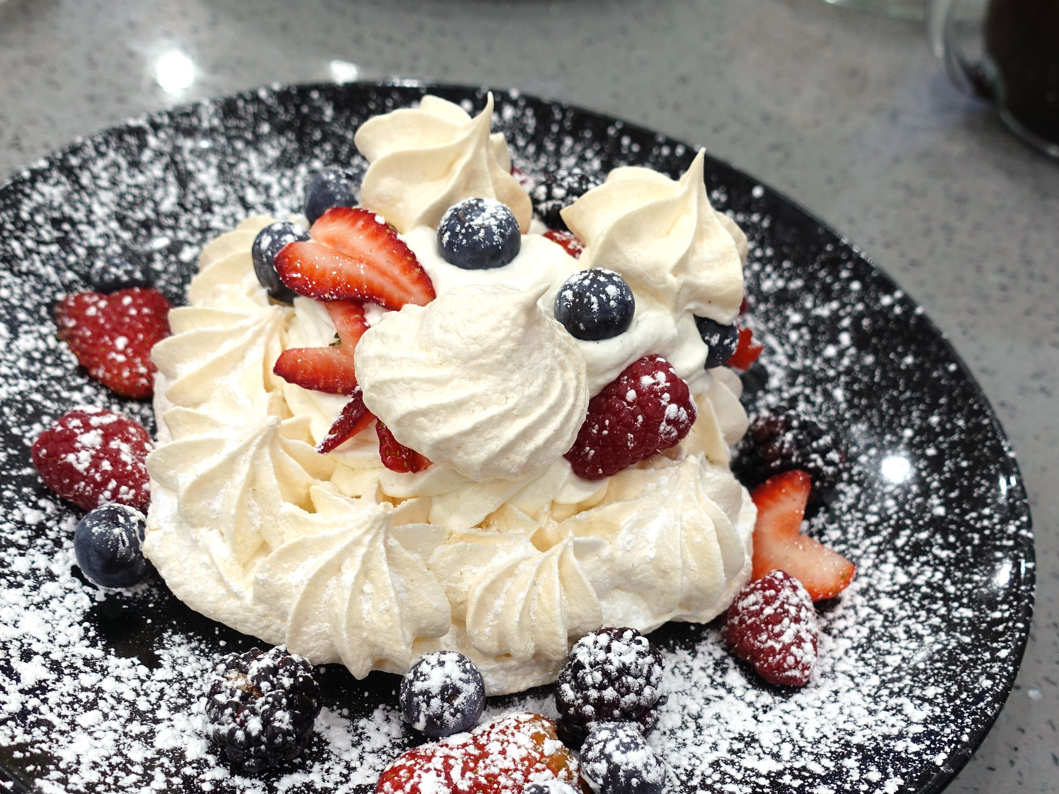 Red, white and blue pavlova with meringue, whipped cream and fresh berries at Sweetest Season Artisan Eatery in Tempe.