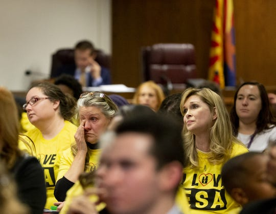 Kathy Visser, of Scottsdale, left, and Cherie Higgins, of Phoenix listen during a hearing on school vouchers in a senate hearing room at the state Capitol in Phoenix on February 13.
