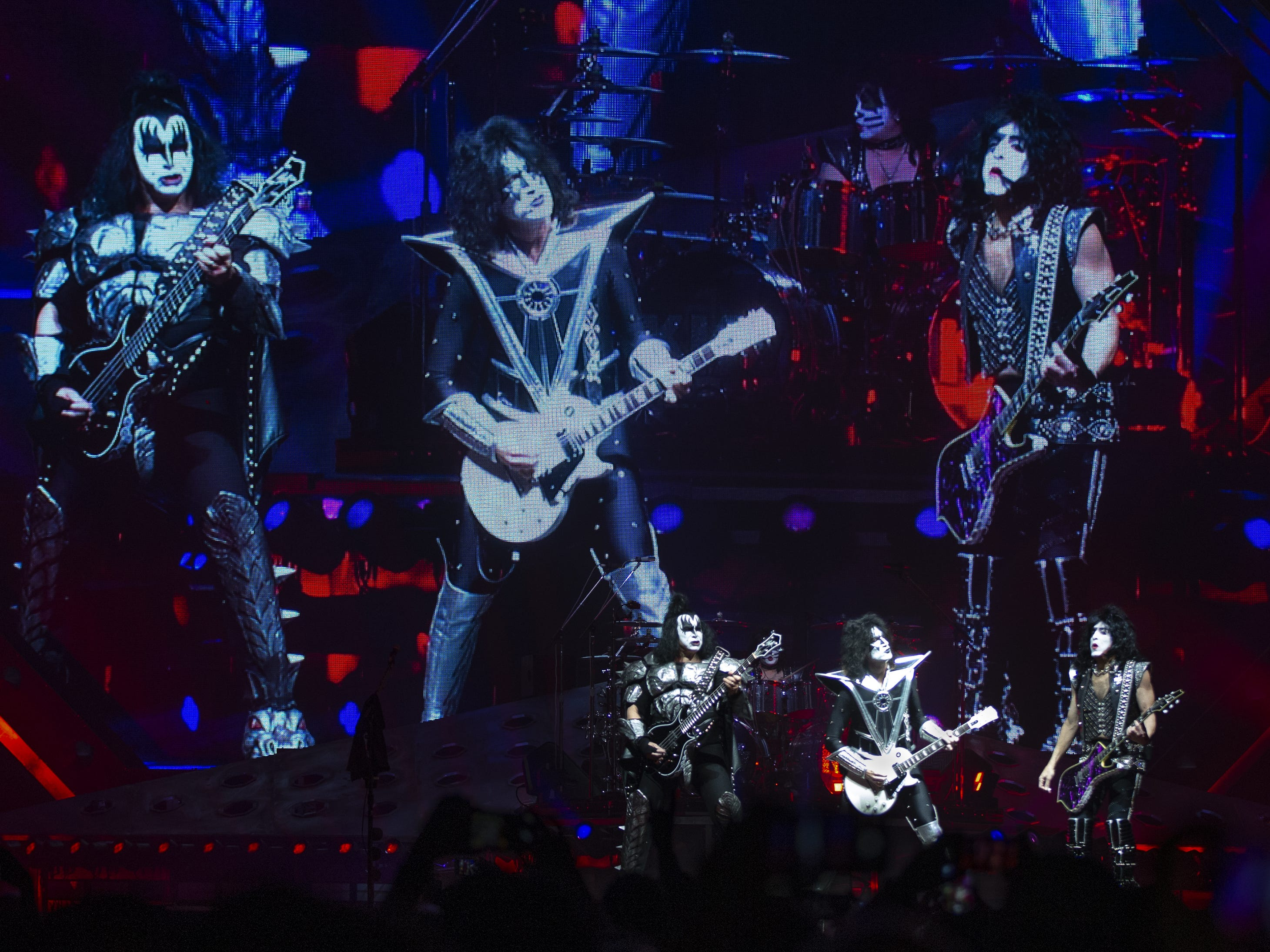 "Kiss plays the opening number, ""Detroit Rock City,"" at Gila River Arena during the End of the Road World Tour stop in Glendale, Wednesday, Feb. 13, 2019. Thousands of fans came to see the band's farewell concert. From left to right are Gene Simmons, Tommy Thayer, Eric Singer and Paul Stanley."
