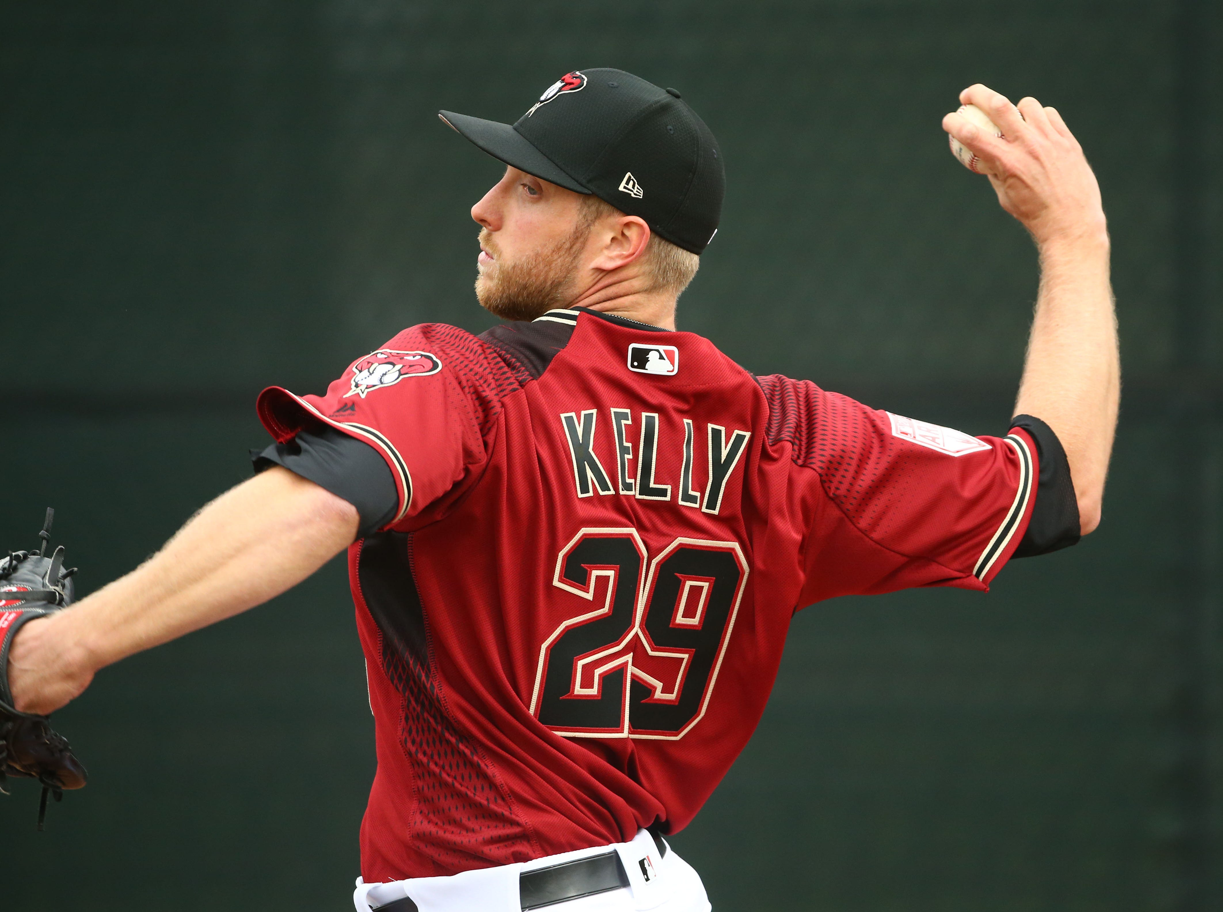 Arizona Diamondbacks Merrill Kelly (29) in the bullpen during the first day of spring training workouts on Feb. 13 at Salt River Fields in Scottsdale.