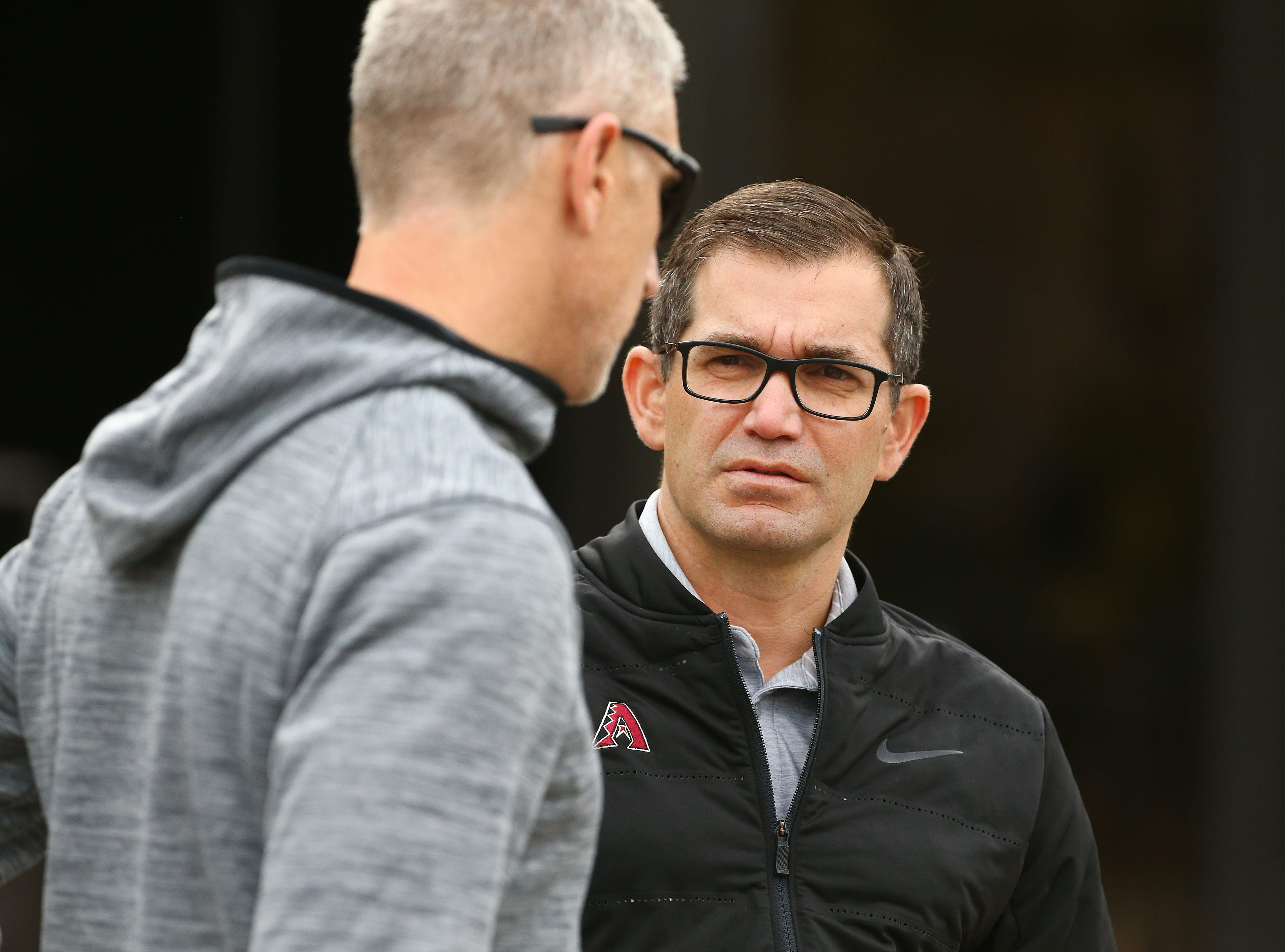 Amiel Sawdaye, (right) Senior VP & Assistant GM talks to Michael Bell, Director of Player Development for the Arizona Diamondbacks during the first day of spring training workouts on Feb. 13 at Salt River Fields in Scottsdale.