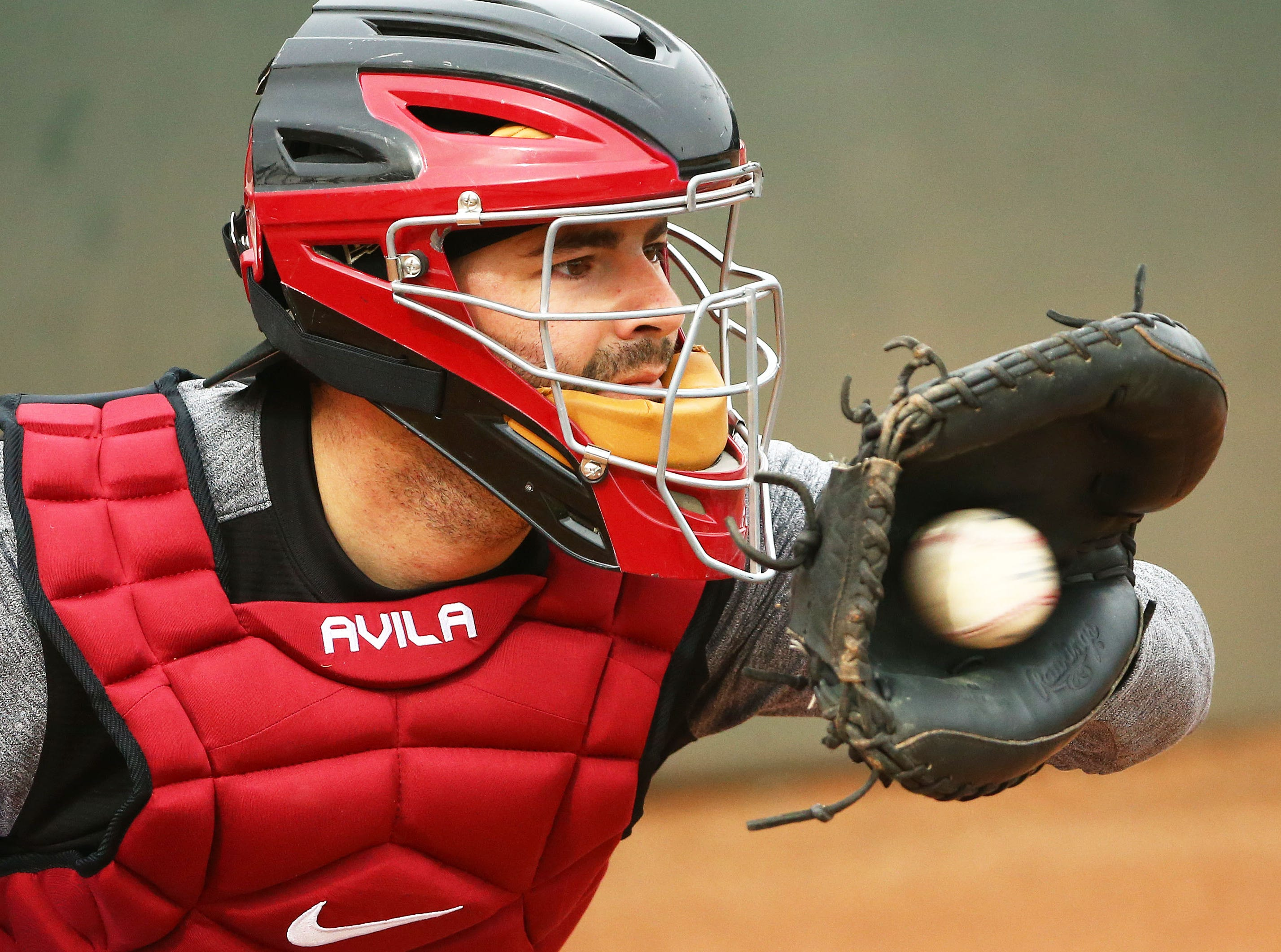 Arizona Diamondbacks catcher Alex Avila works the bullpen during the first day of spring training workouts on Feb. 13 at Salt River Fields in Scottsdale.