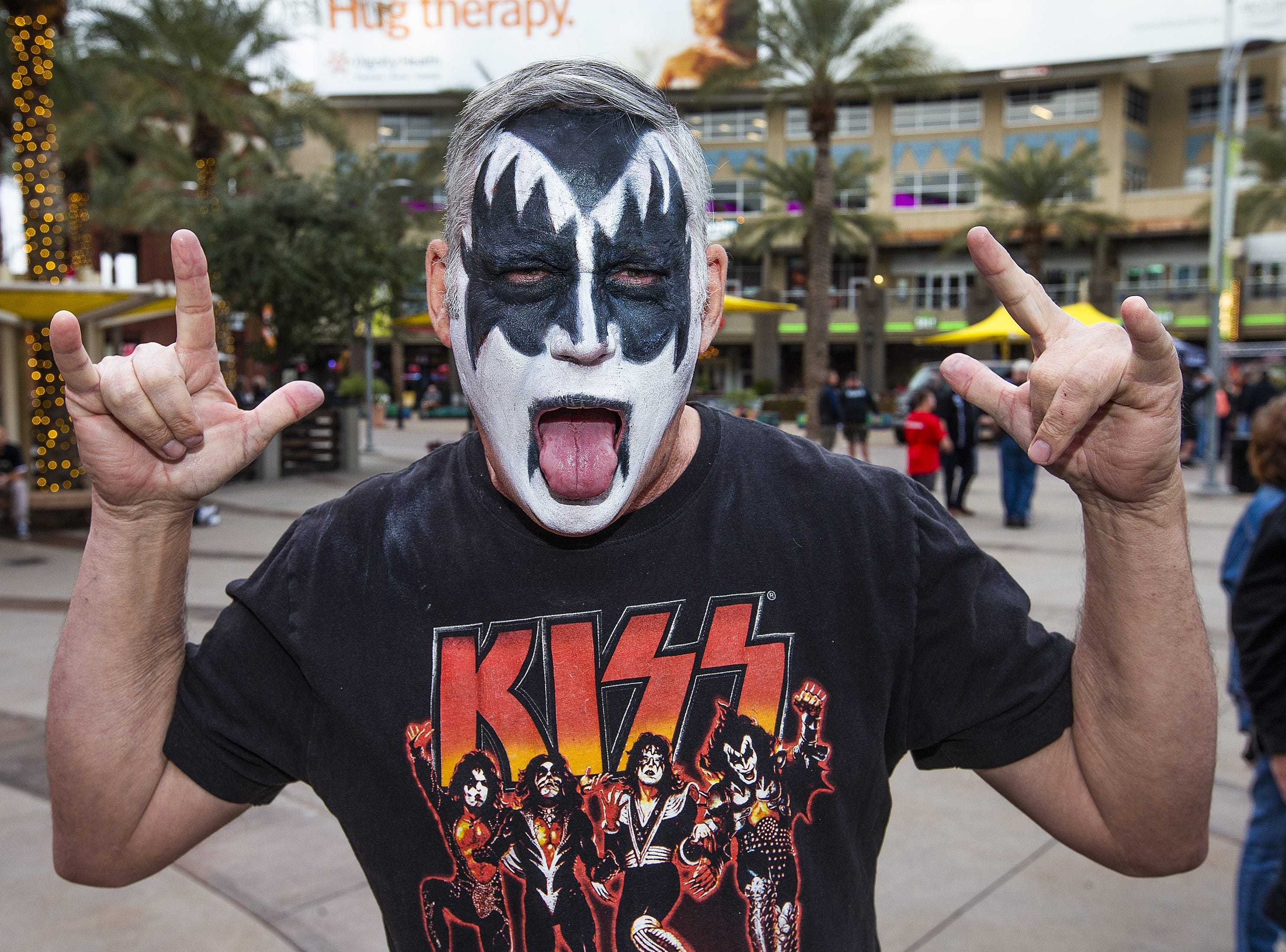 Rodger Walker, 56, of Phoenix, shows off his best KISS makeup prior to the concert by the famed group at Gila River Arena in Glendale on Wednesday, Feb. 13, 2019.  The concert was part of the End of the Road World Tour, the band's farewell to the fans.
