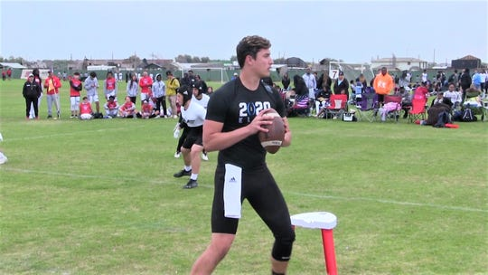 Saguaro quarterback Tyler Beverett prepares to throw at a 7-on-7 event.